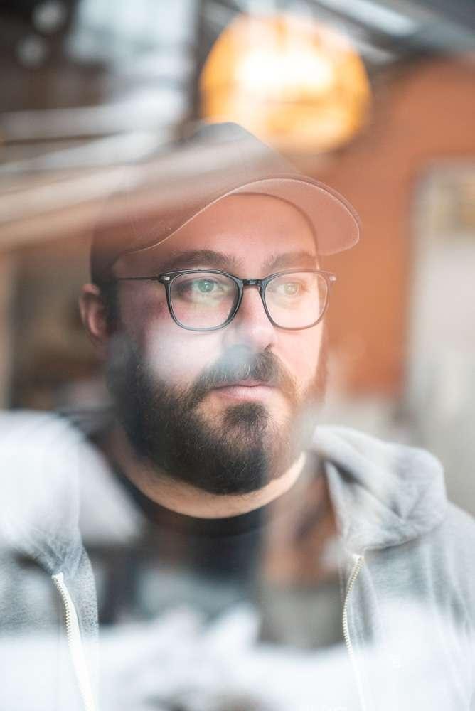 portrait of chef Simon Mathys of Manitoba restaurant through a window by Bruno Florin