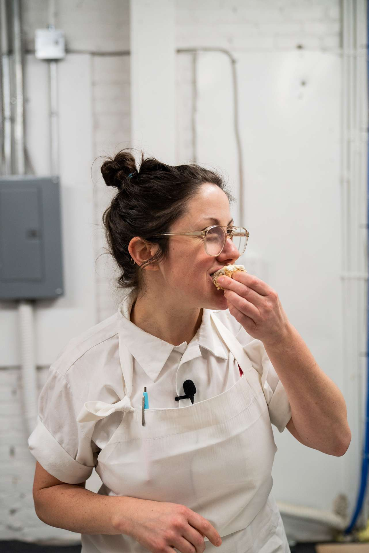 portrait of chef Stephanie Labelle from pastry shop Rhubarbe eating cake by Bruno Florin