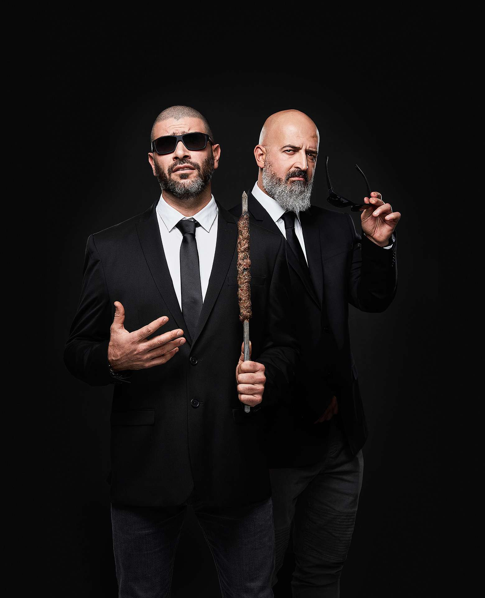 portrait of chefs Charbel Yazbeck and Akram Sleiman posing in a Men in Black Fashin wearing sunglasses looking badass by Jocelyn Michel for the Cathcart