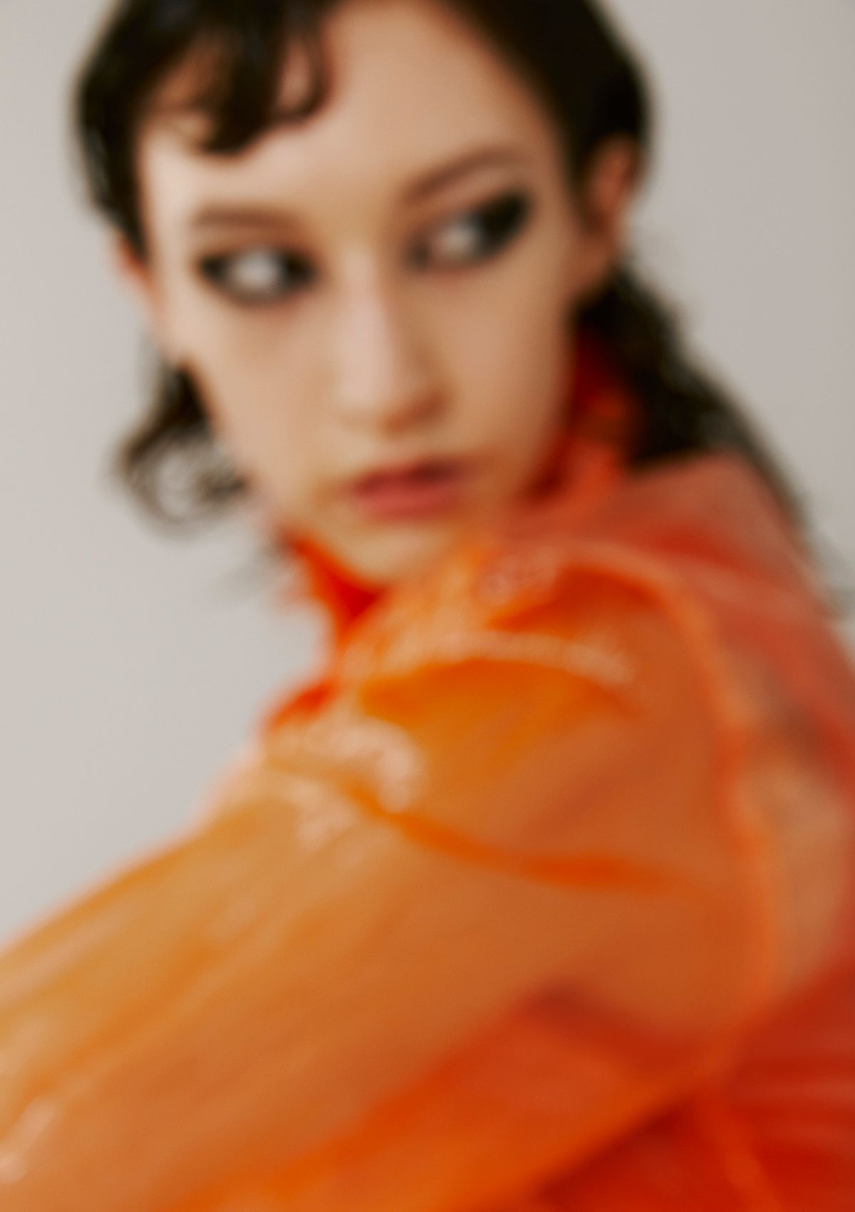 close up of female model all dressed in orange all blurred photographed by Kelly Jacob for Editorial for Contributor Magazine