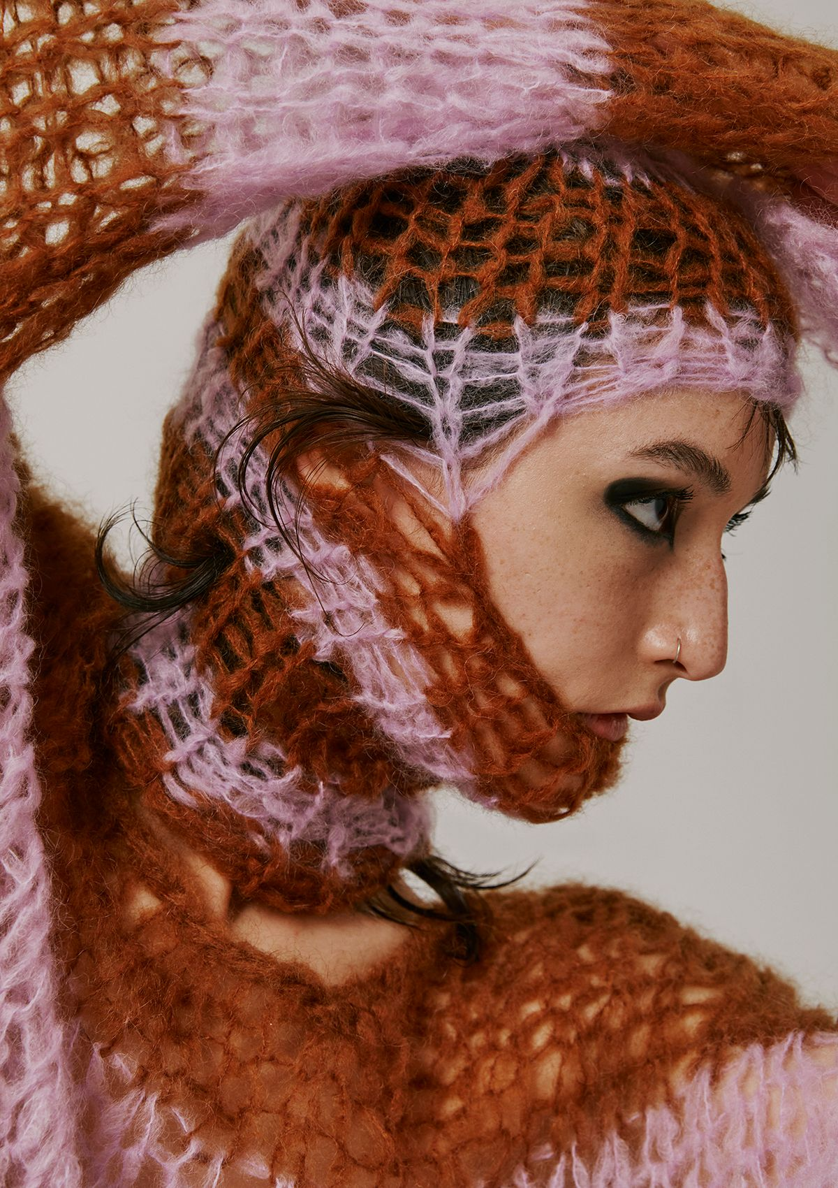close up of female model wearing loosely knit brown and pink shirt and balaclava photographed by Kelly Jacob for Editorial for Contributor Magazine