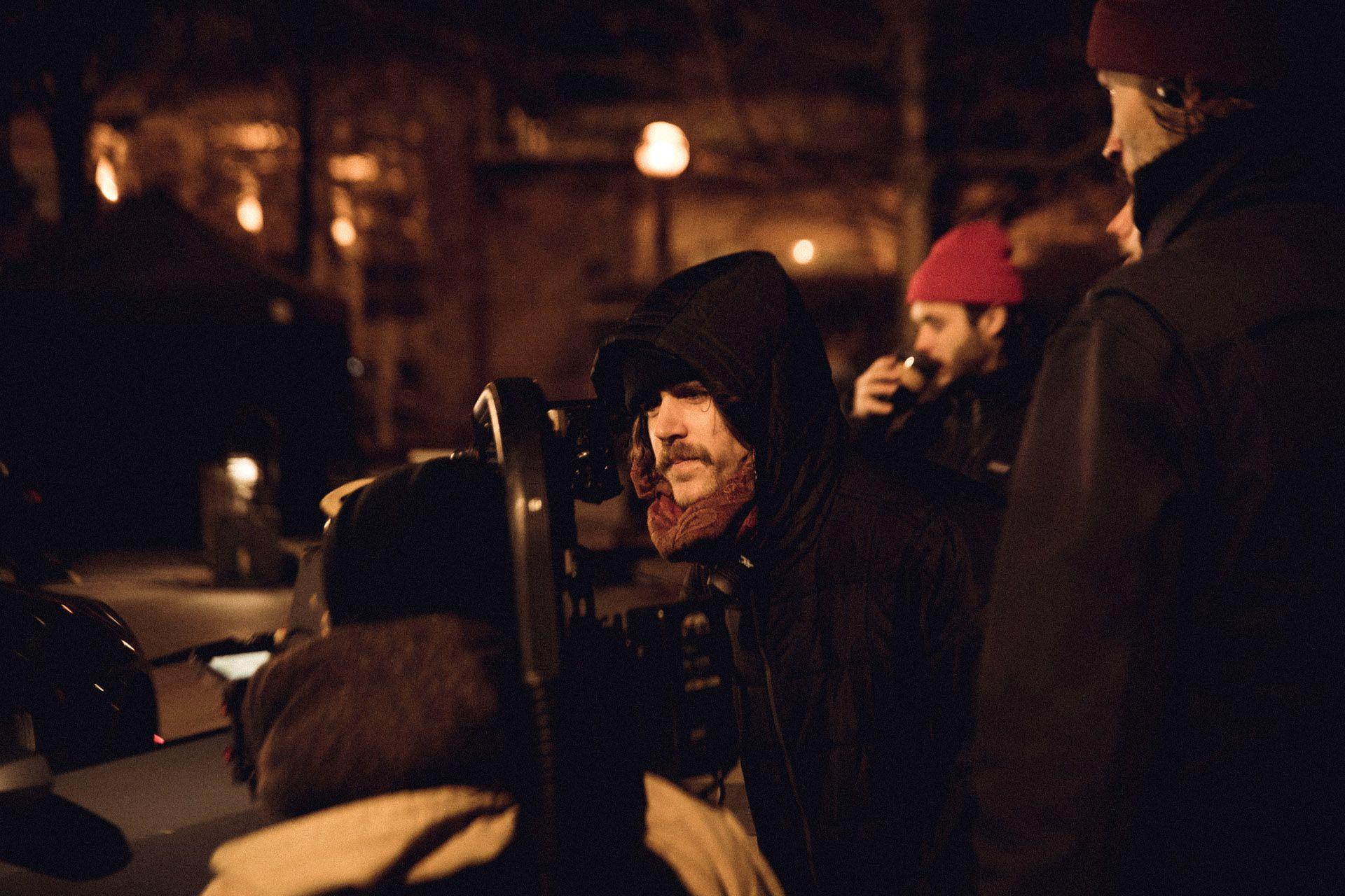 Vincent Ruel-Cote from Les Gamins behind the scenes filming TV series La Loi C'est La Loi at night with TV5 Unis