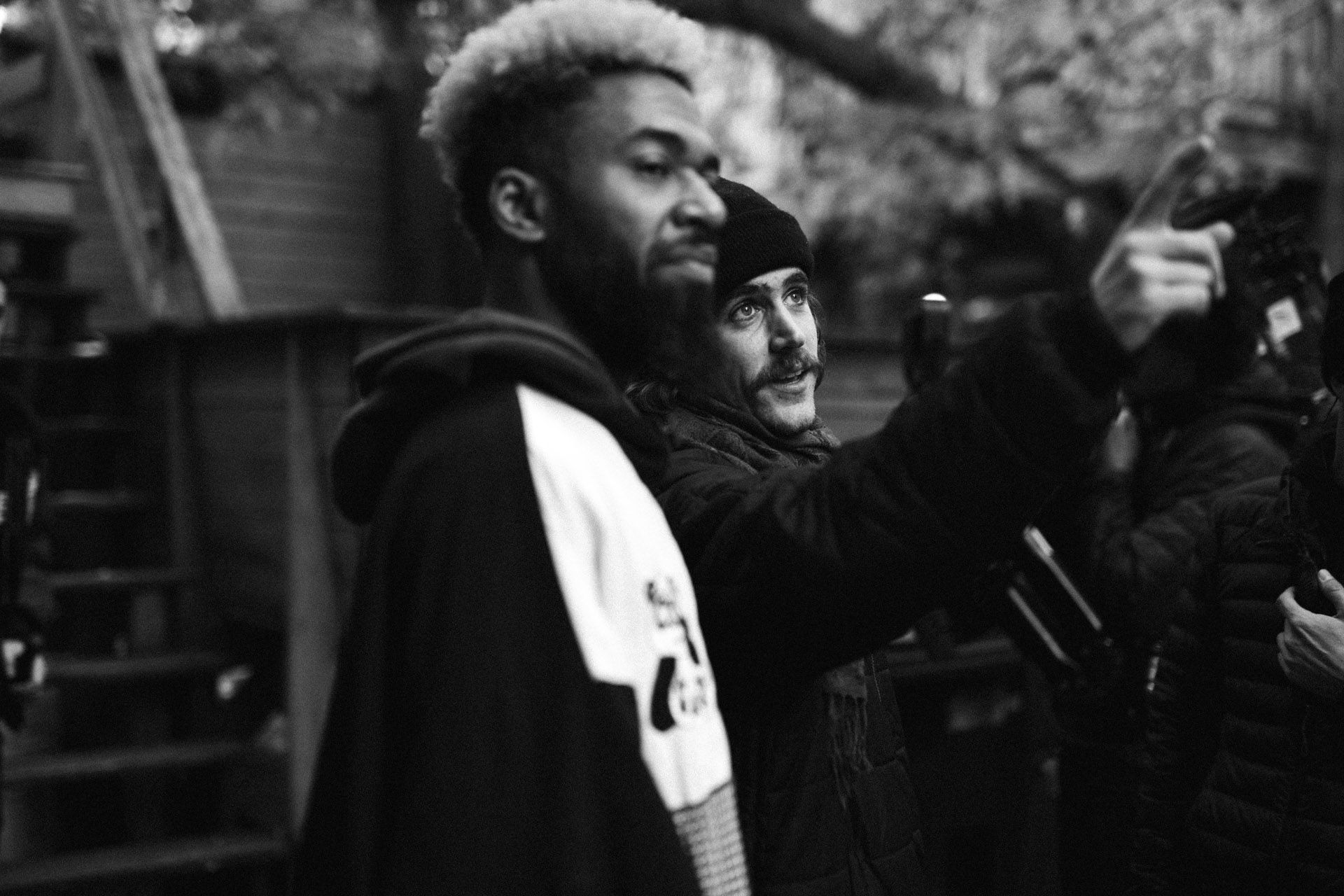 Vincent Ruel-Cote from Les Gamins giving directions to to black actor with bleached hair in behind the scenes filming TV series La Loi C'est La Loi at night with TV5 Unis