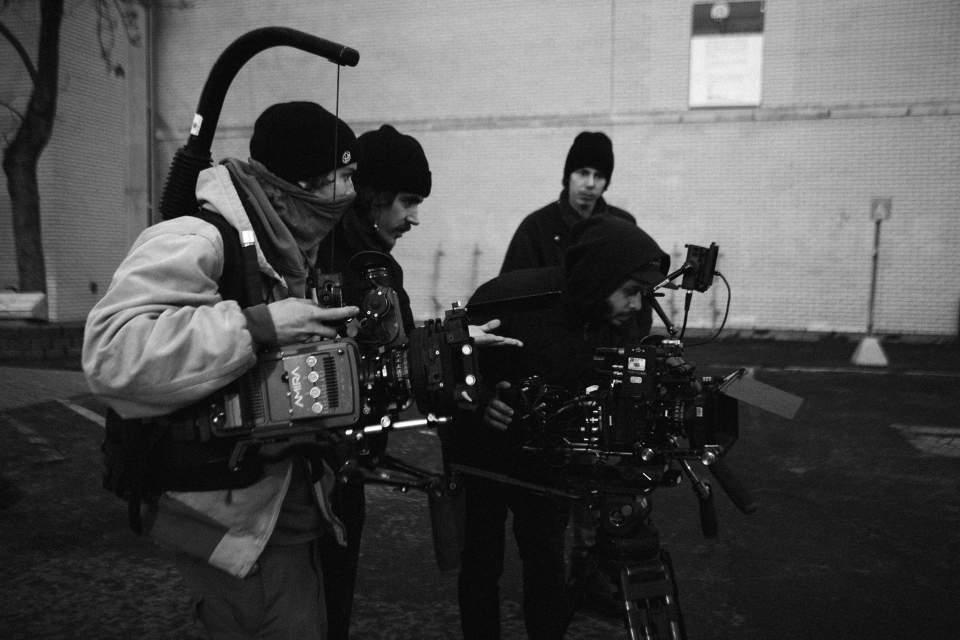 Vincent Ruel-Cote from Les Gamins checking footage screen with assistants in behind the scenes of TV series La Loi C'est La Loi with TV5 Unis