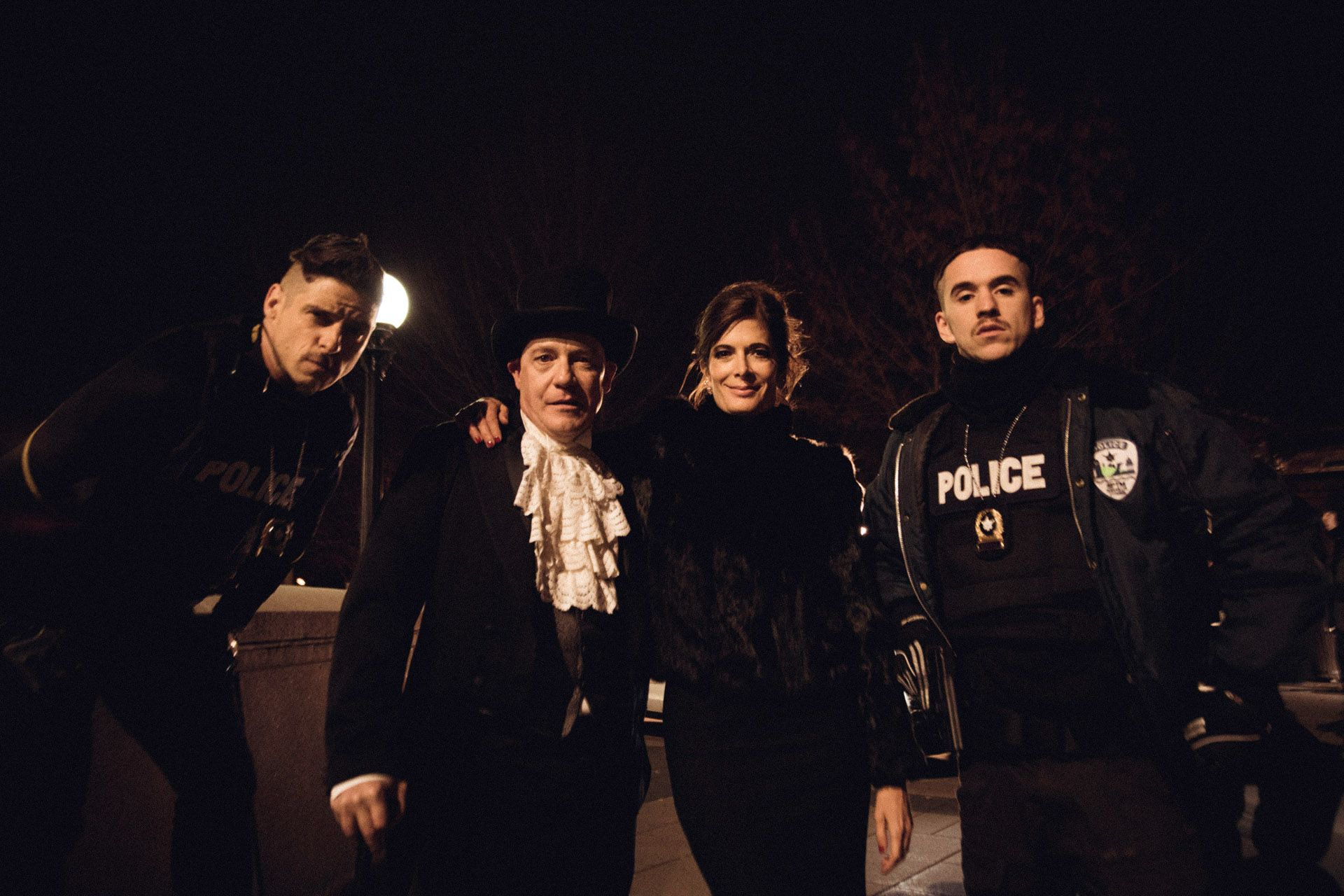 actors Hugolin Chevrette-Landesque and Emile Schneider dressed as cops with two of their co-actors posing for pictures in front of Marche Maisonneuve in behind the scenes for TV series La Loi C'est La Loi filmed by Les Gamins for TV5 Unis