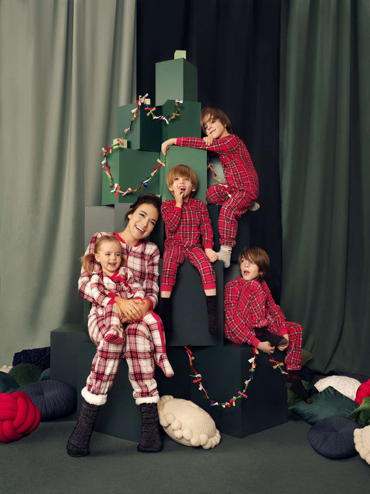 portrait of family of Maman Caffeine in festive decor wearing matching pajamas with her four children for Aubainerie Christmas campaign about united family photographed and filmed by Maxyme G Delisle with artistic direction and set design by Studio TB