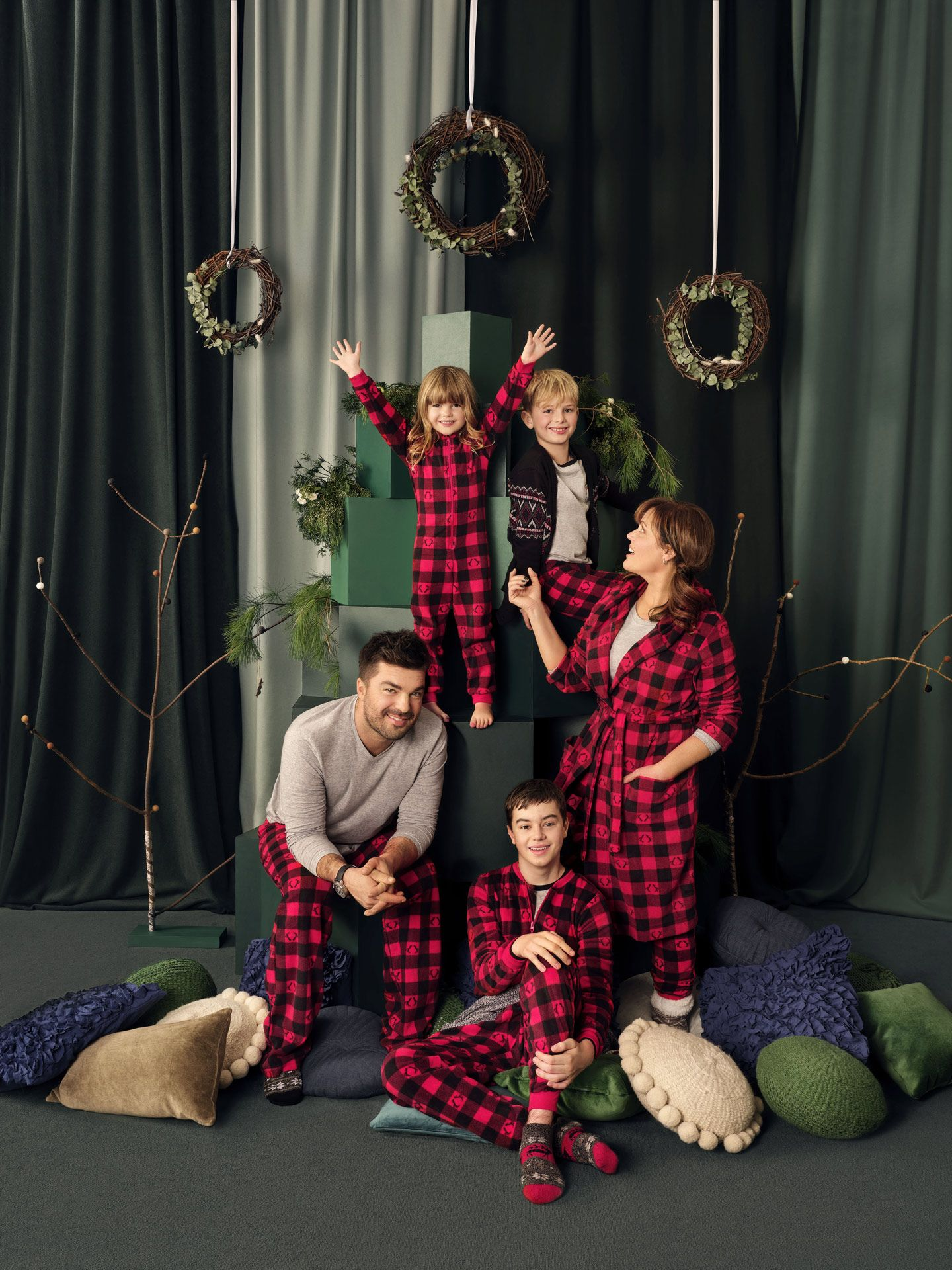 portrait of family Paquin-marcotte in festive decor wearing matching pajamas for Aubainerie Christmas campaign about united family photographed and filmed by Maxyme G Delisle with artistic direction and set design by Studio TB