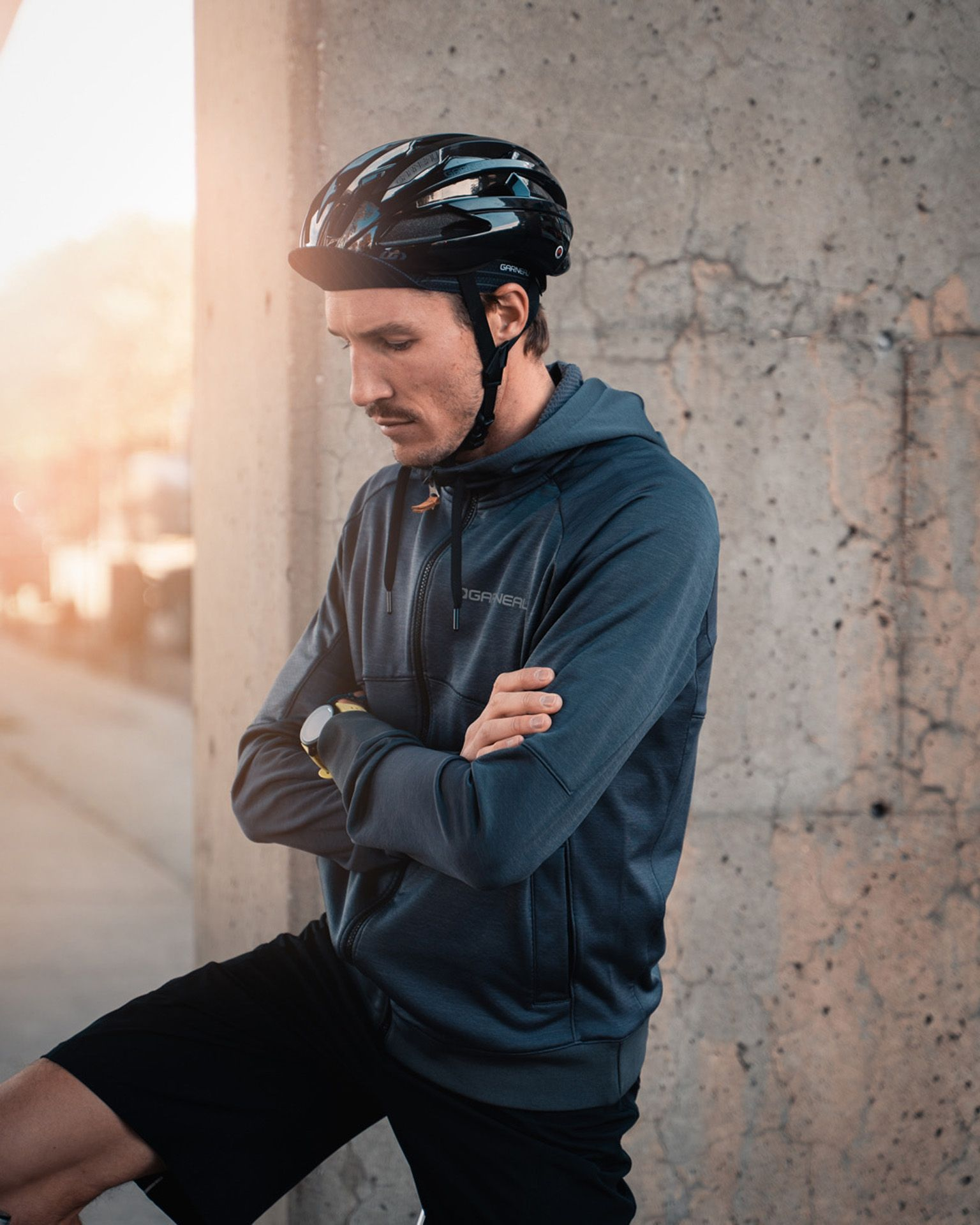 male model wearing bike helmet black shorts and dark blue jacket as Spring Summer 2020 campaign of Louis Garneau with artistic direction and styling by Studio TB