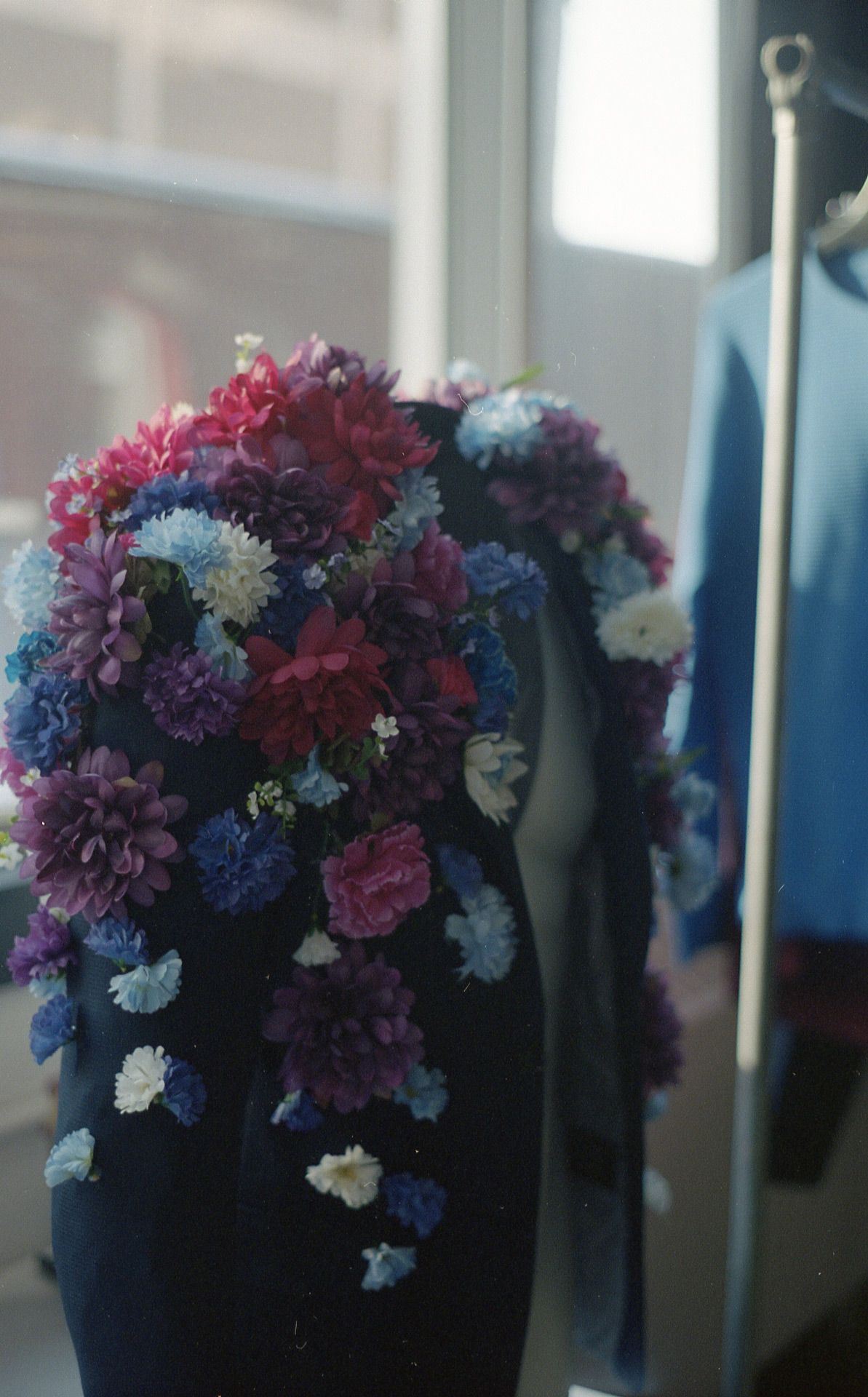 suit jacket covered in fake flowers created by Studio TB for Nouveau Projet 17 with Jean Michel Blais