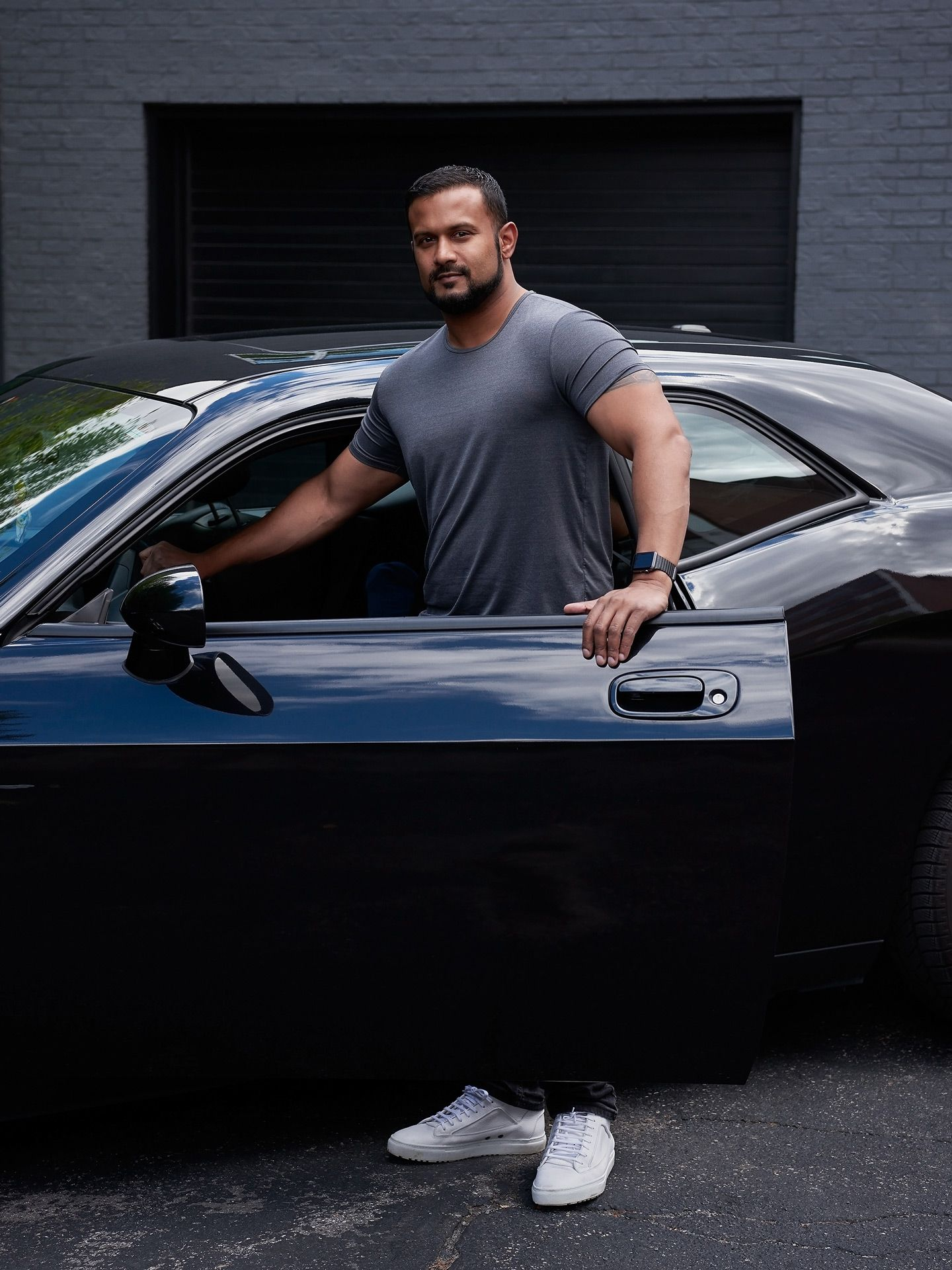 portrait of Dax Dasilva black man next to his car by Guillaume Simoneau