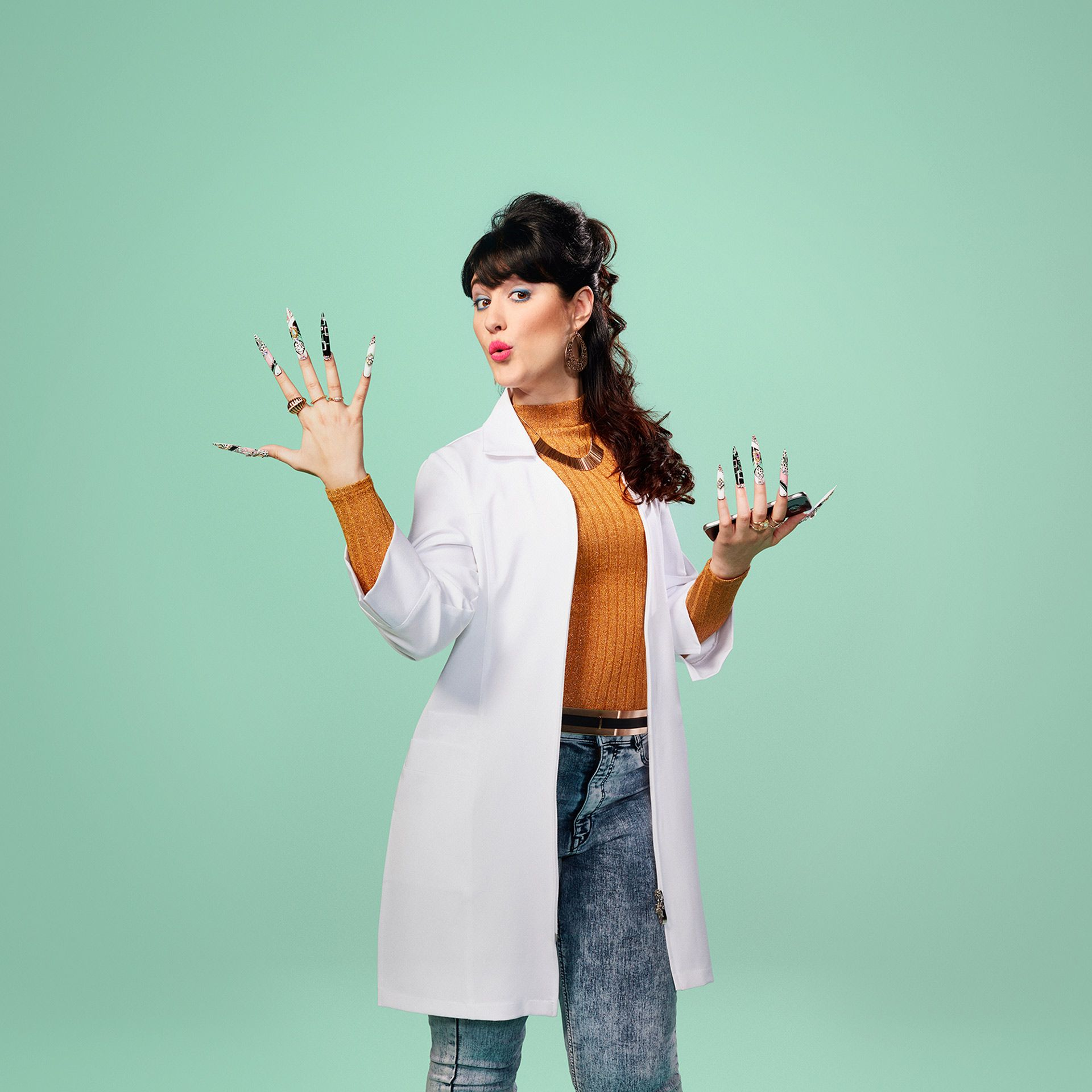 lady dressed as nail technician with extra long nails holding phone looking happy by Jocelyn Michel for Desjardins Assurance with Lg2