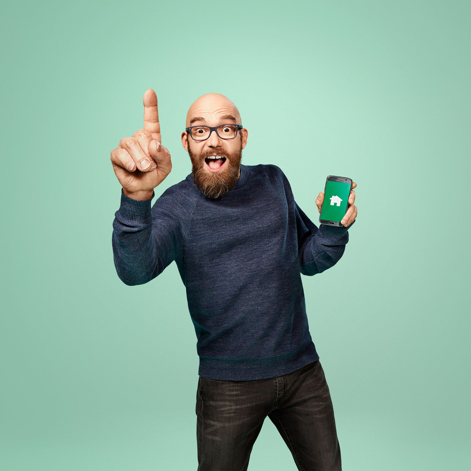 bald man with huge hand looking surprised holding phone by Jocelyn Michel for Desjardins Assurance with Lg2