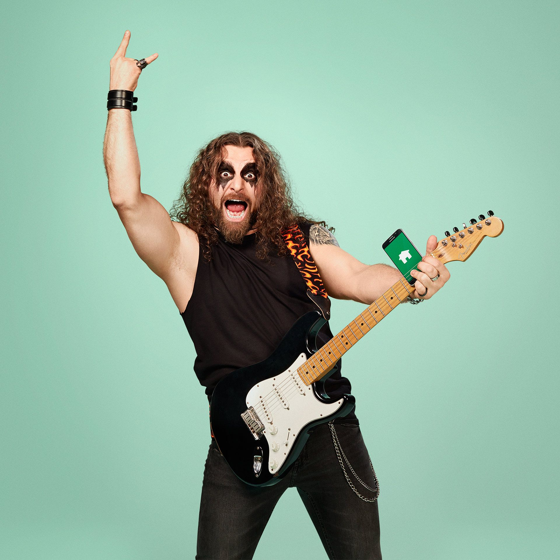 hard metal guy holding guitar with phone tongue sticking out by Jocelyn Michel for Desjardins Assurance with Lg2