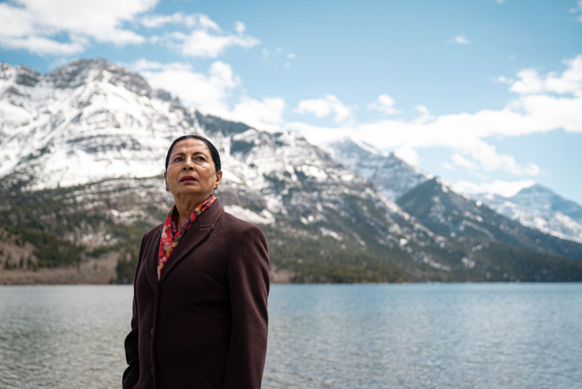 indigenous woman posing in front of snowy mountains and lake by Bruno Florin for BDC Beyond Business with Cossette