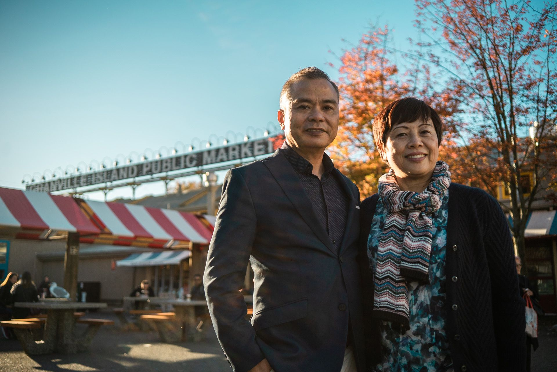 asian couple posing in front of public market in autumn by Bruno Florin for BDC Beyond Business with Cossette