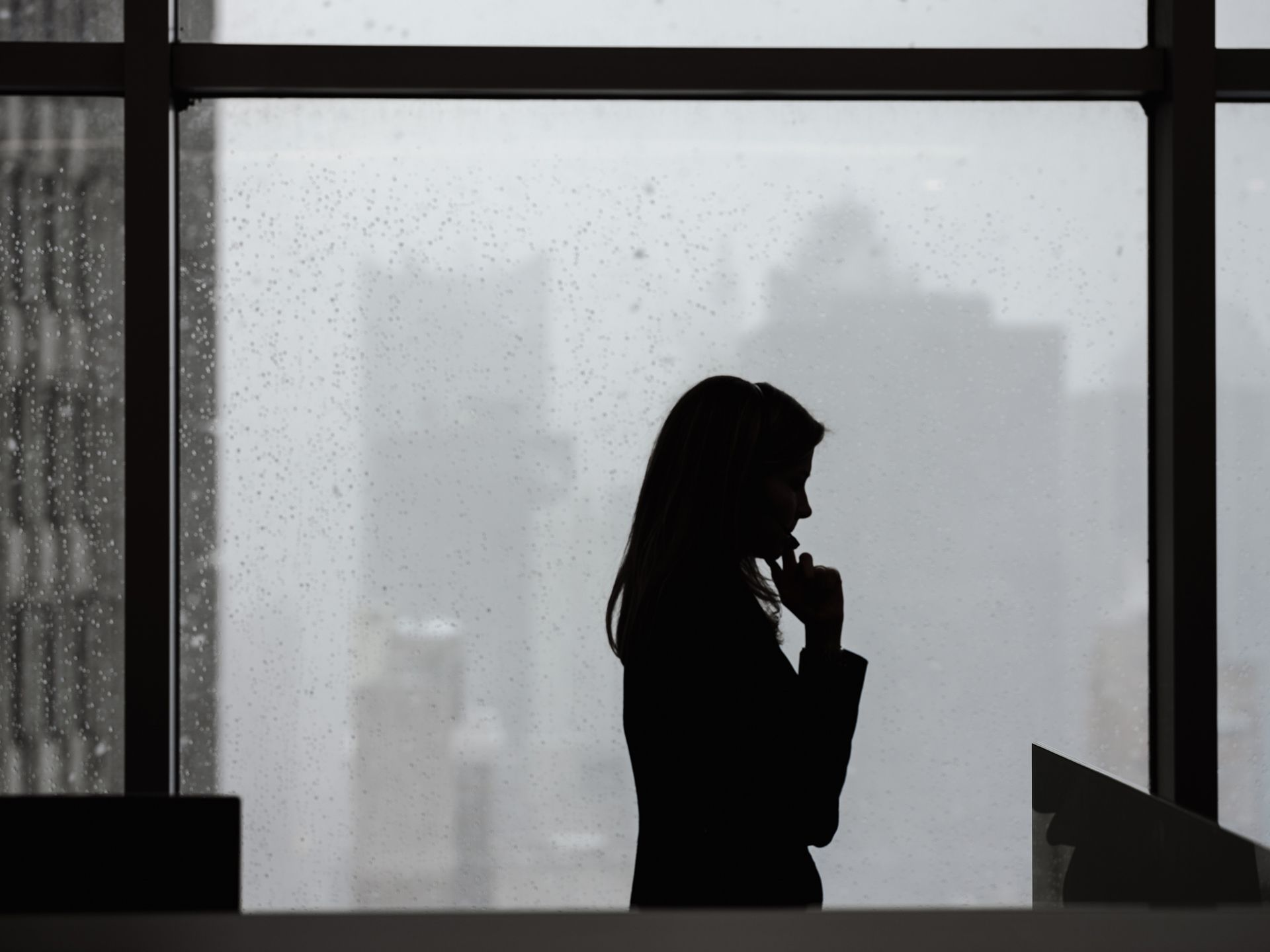 silhouette of women on the phone in a window splattered with rain by Alexi Hobbs for PSP