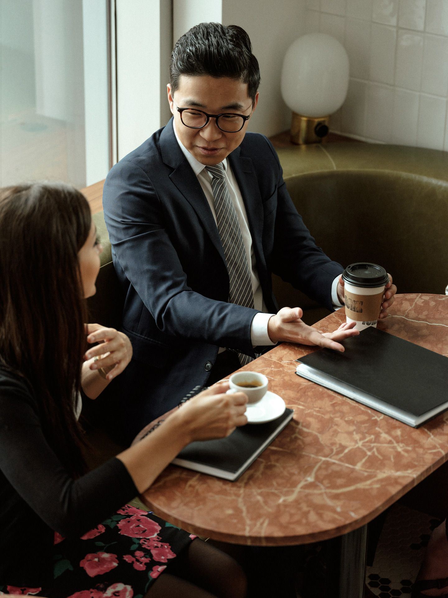 two people dressed professionally talking while drinking coffee photographed by Alexi Hobbs for PSP