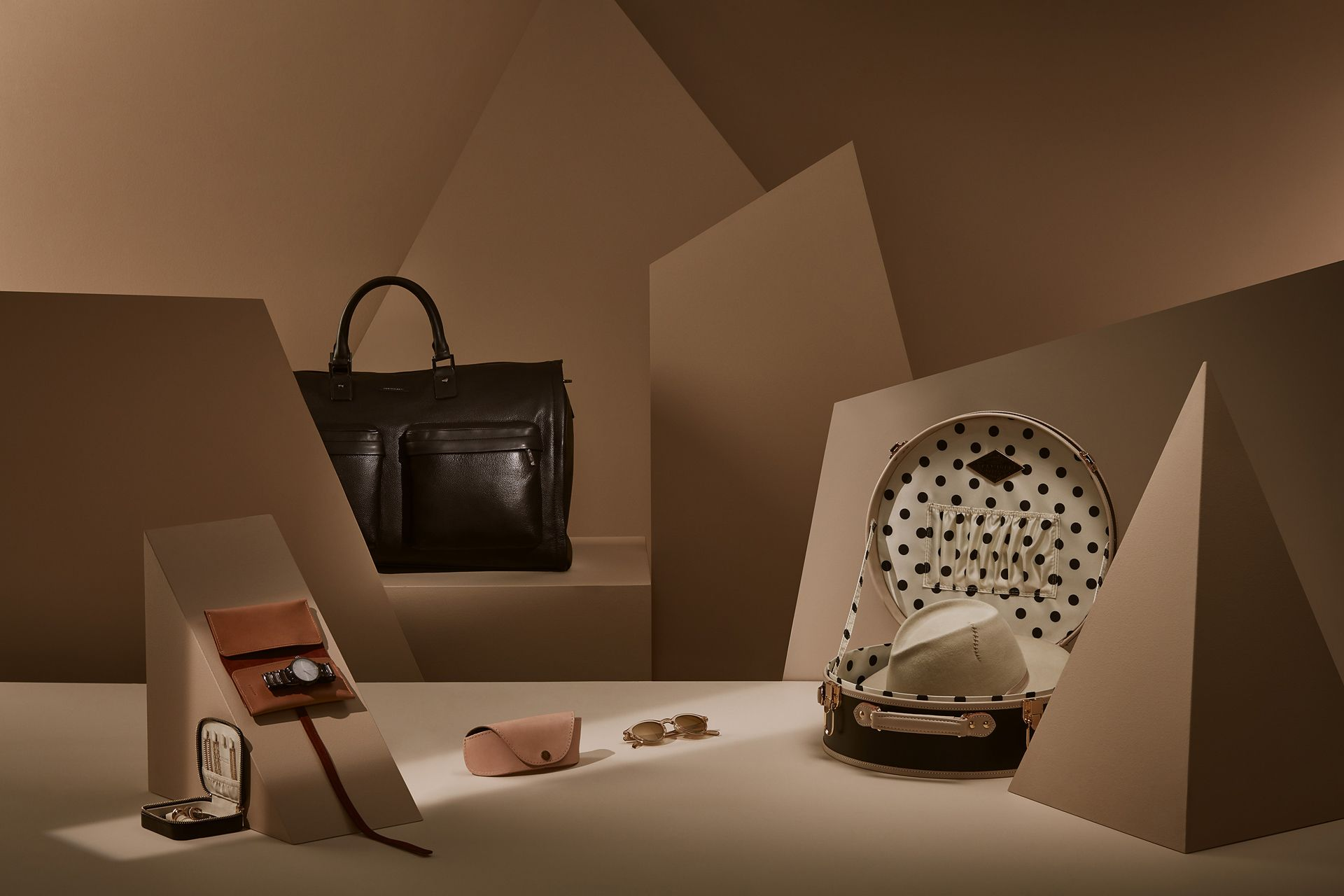 leather bags within different types of shapes by Mathieu Levesque for enRoute