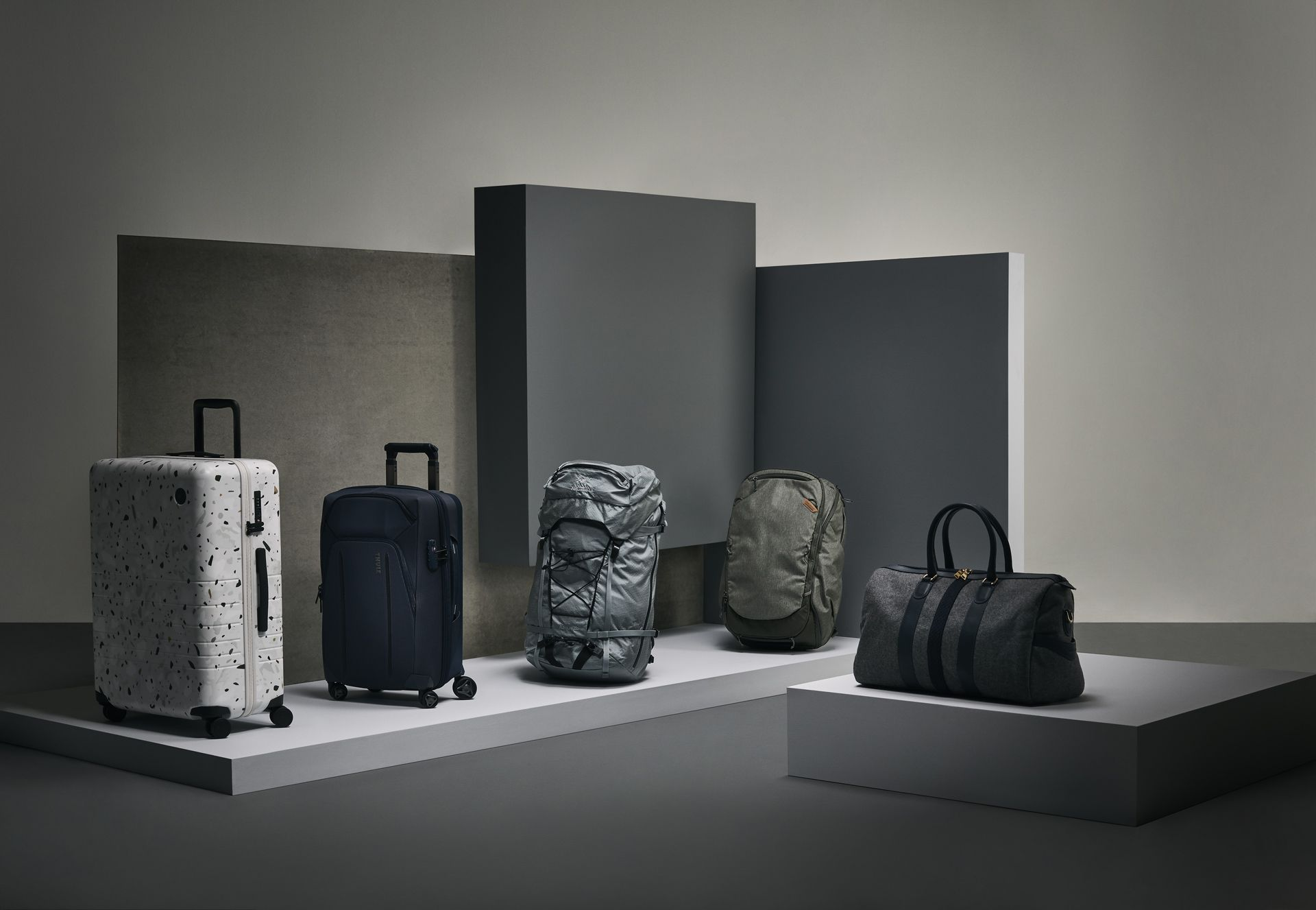 different types of travel bags and luggages on grey background by Mathieu Levesque for enRoute