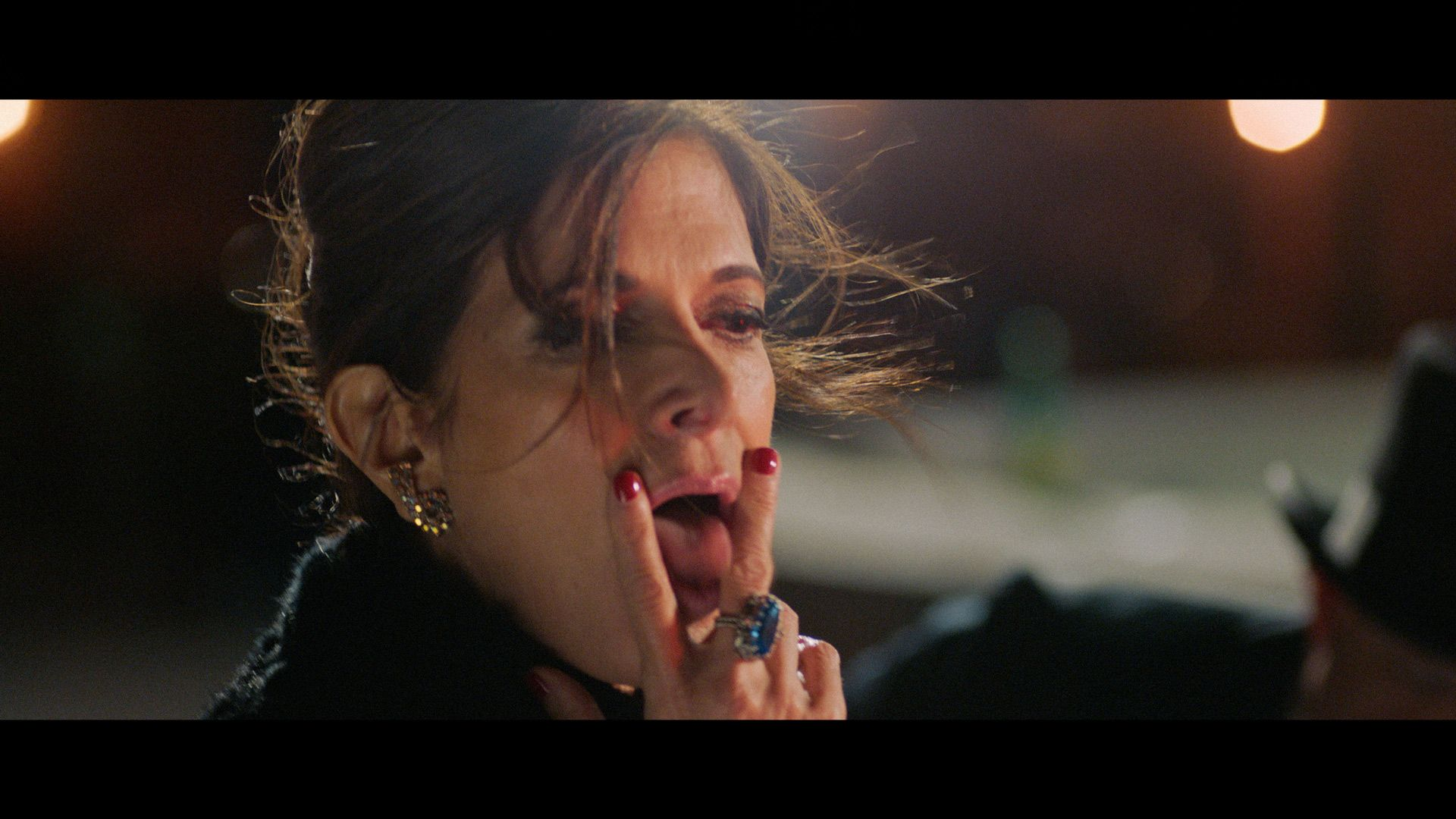 actress forming V with her fingers and sticking her tongue in between them with her hair in the wind for TV series La Loi C'est La Loi filmed by Les Gamins for TV5 Unis