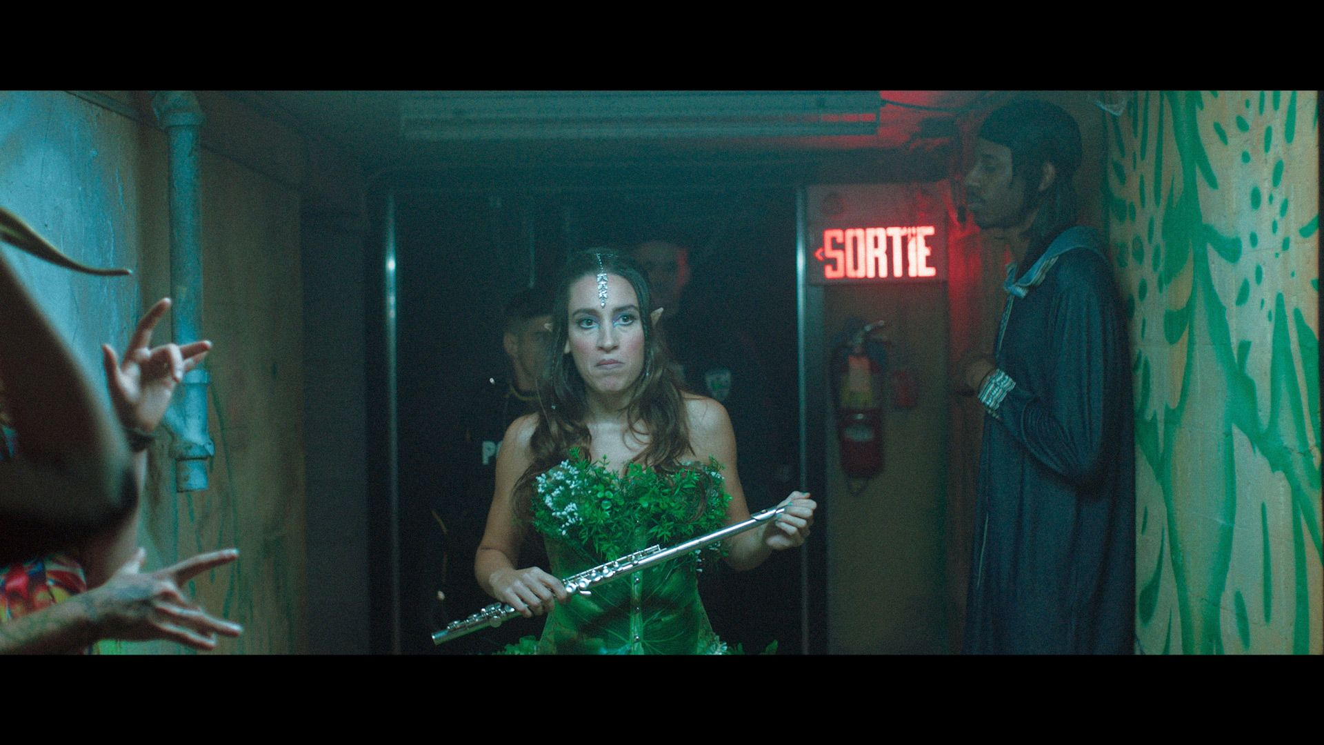 actress disguised as fairy with a flute walking in a corridor in TV series La Loi C'est La Loi filmed by Les Gamins for TV5 Unis