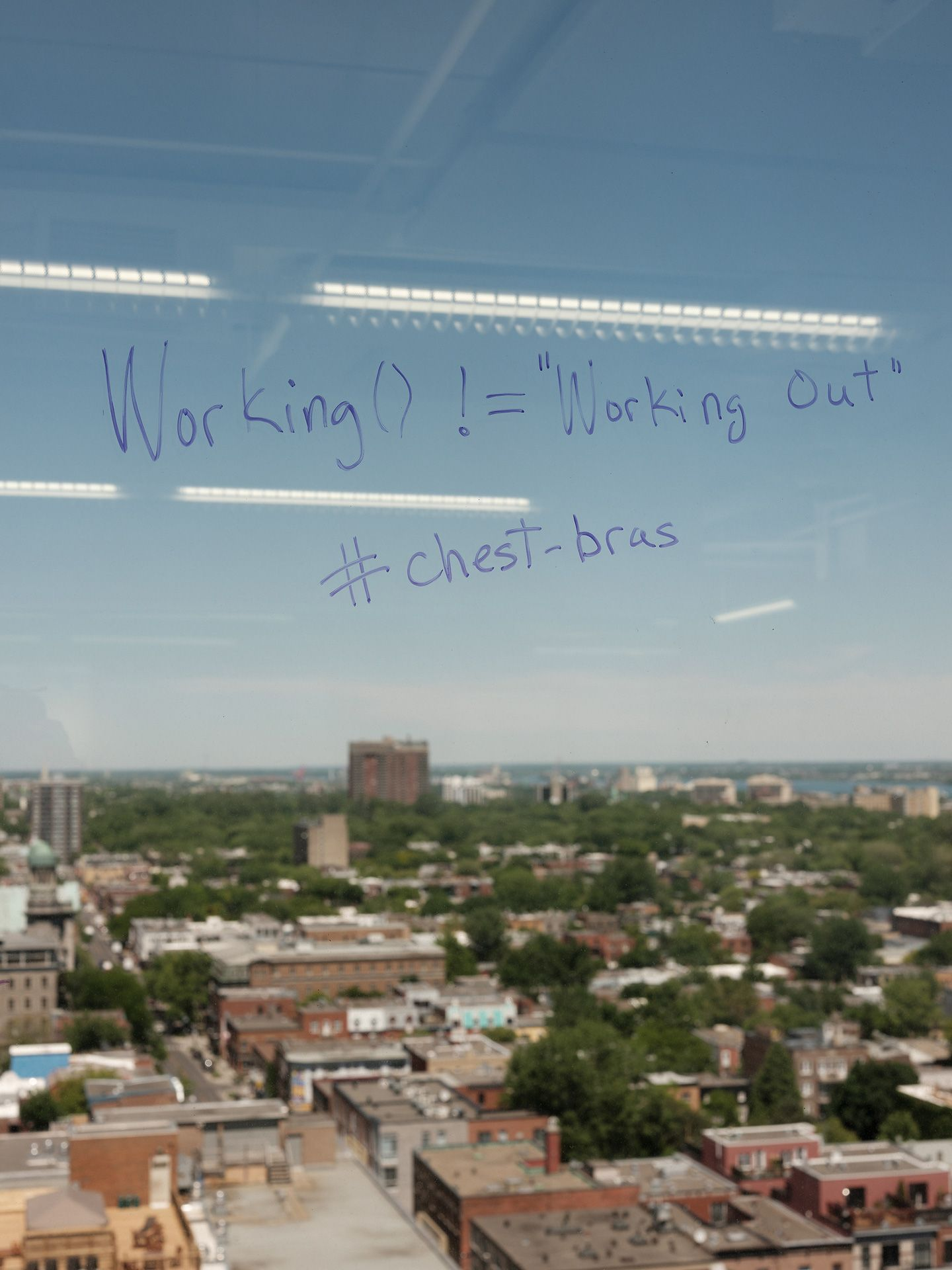 words about working out written on window by Guillaume Simoneau for Element AI with Fortune Magazine