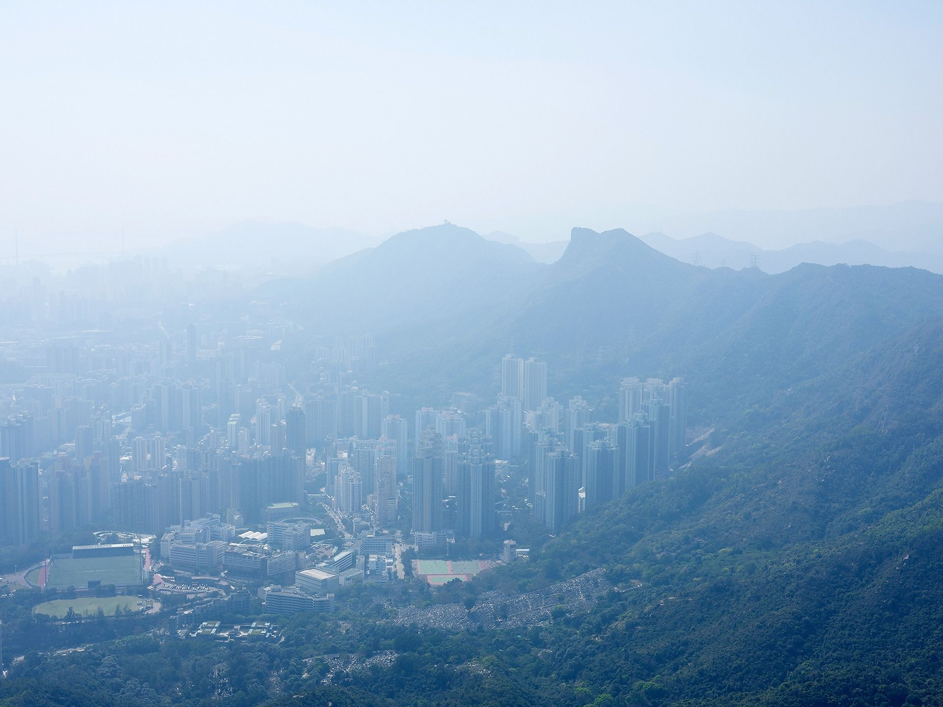 top view of city of Hong Kong in Japan by Guillaume Simoneau