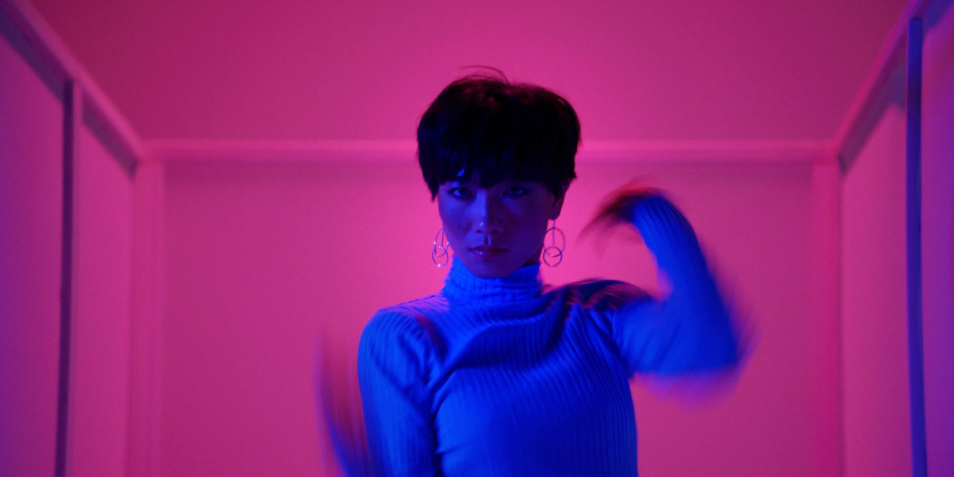 asian female dancer in pink lighting by Simon Duhamel for It's Coming Down for Fabrikate