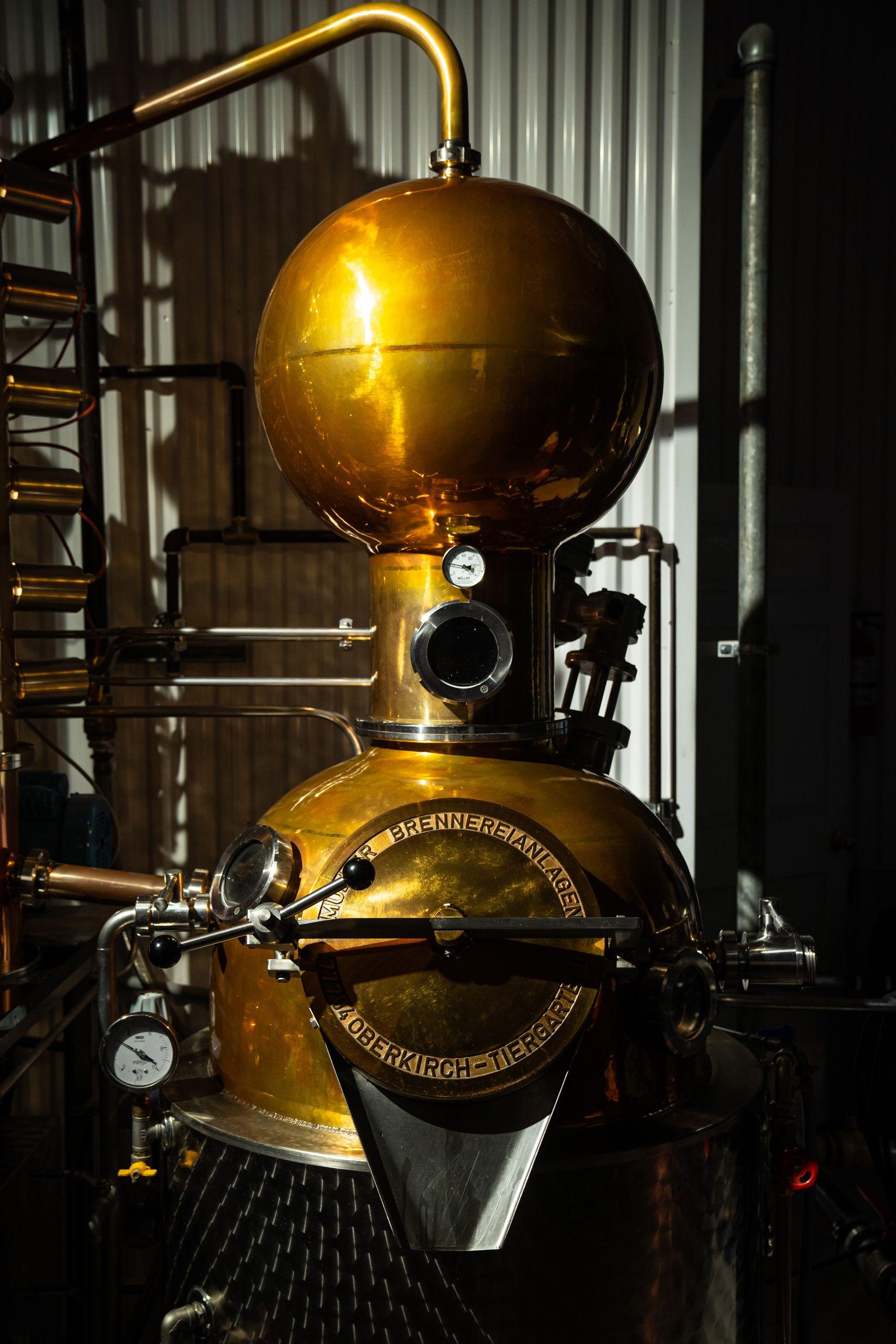 Image of gold and steel distillation machine.
