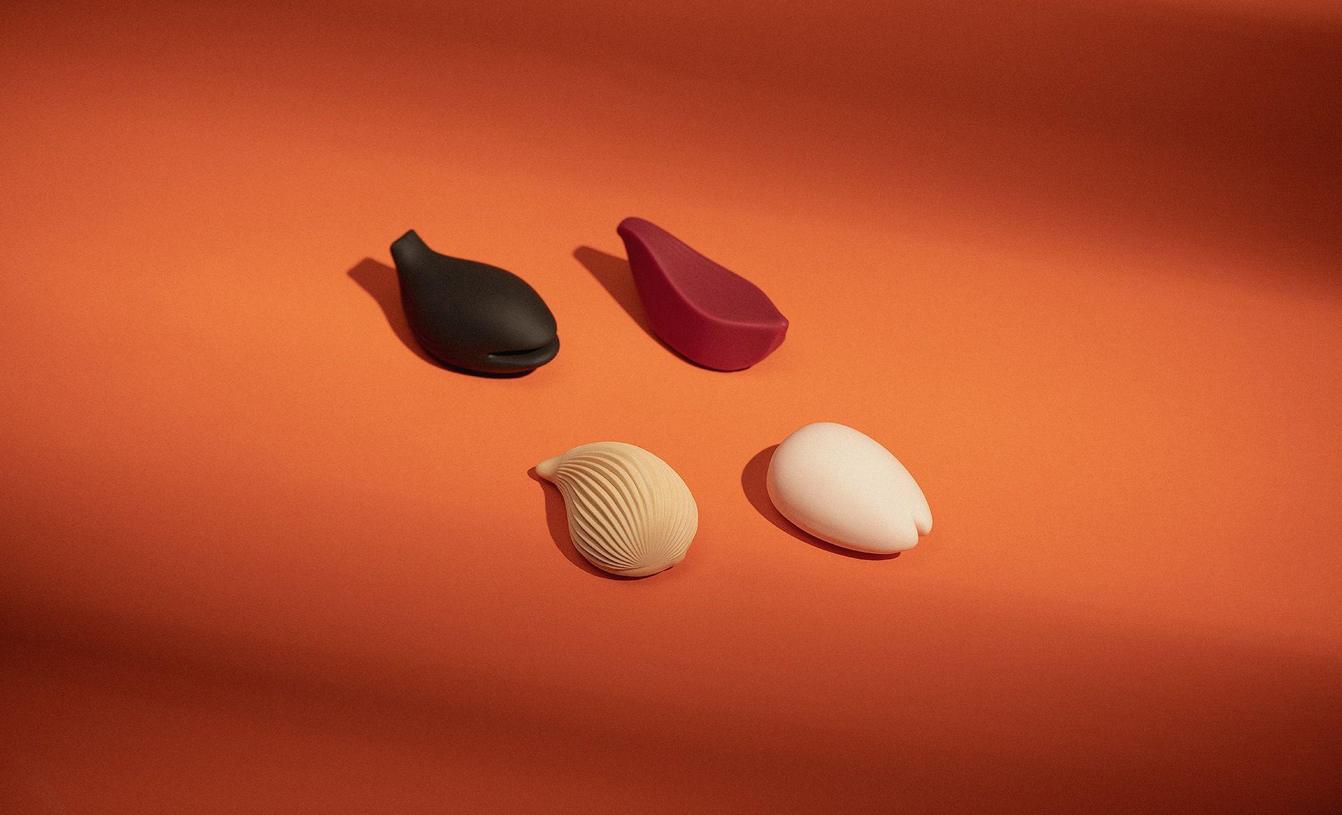 Iroha kushi Japan clitoral vibrators on an orange background.