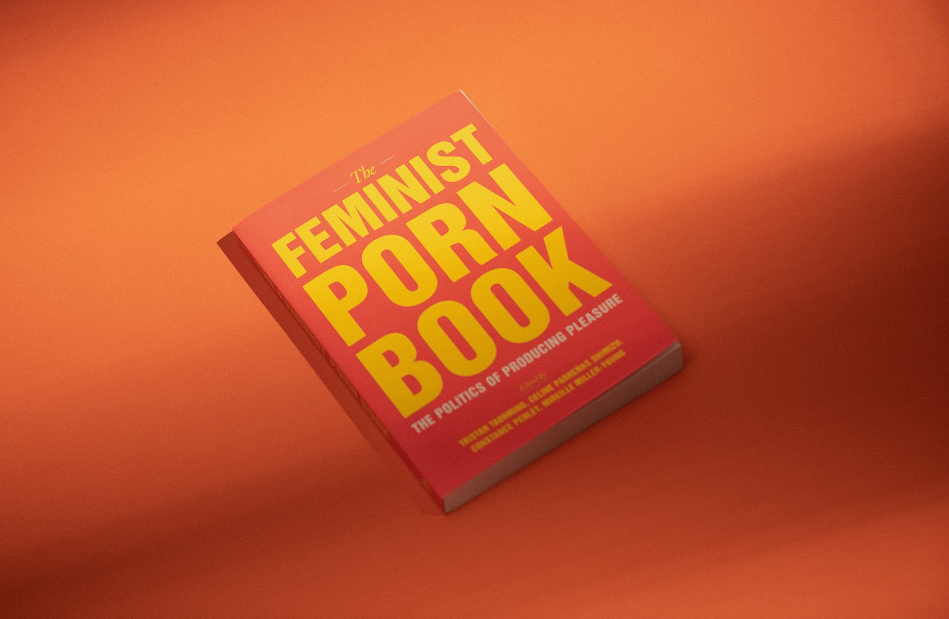 Book with a soft cover of an orange tint titled THE FEMINIST PORN BOOK in yellow on an orange background.