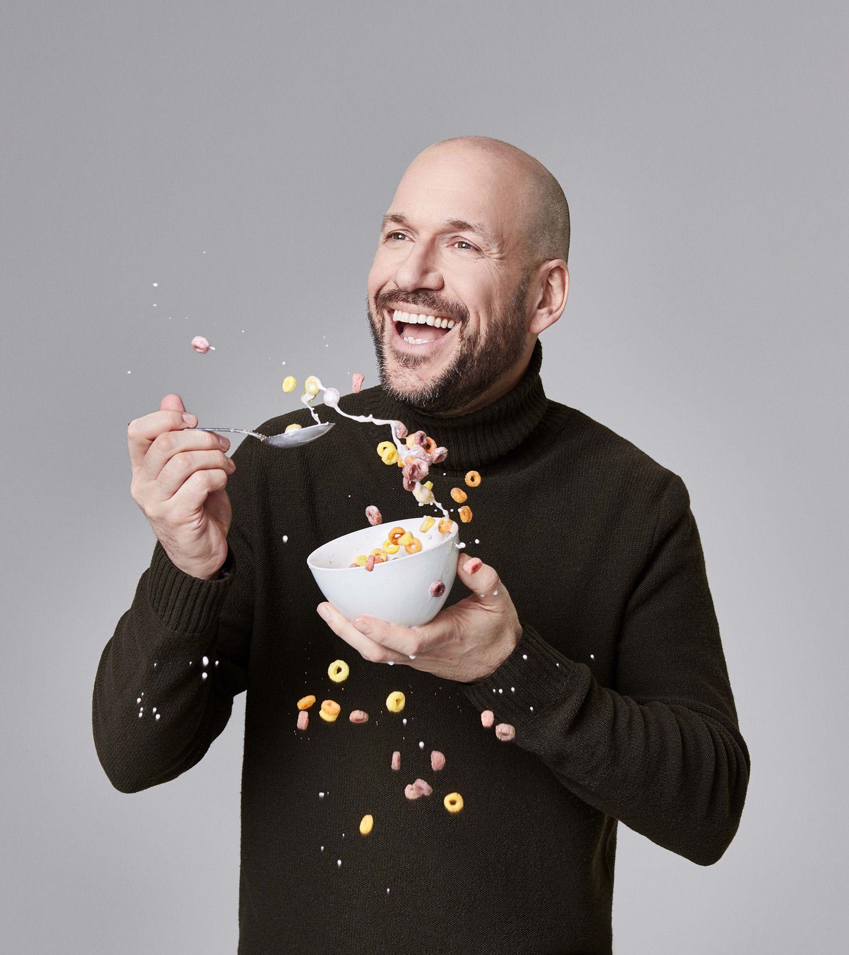 Martin Matte celebrity male portrait huge smile with bowl of fruit loops some cereal flying out by Jocelyn Michel