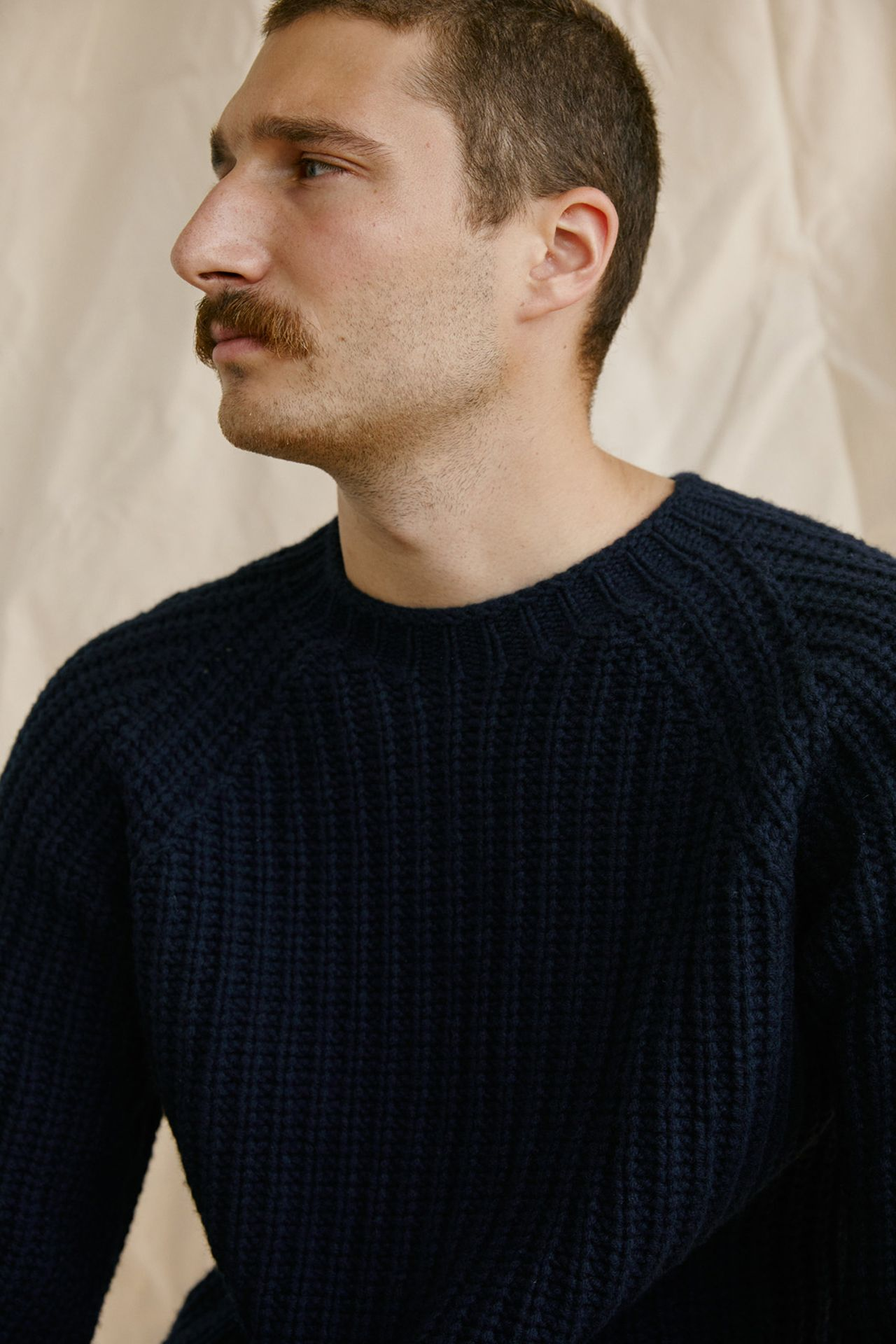 Premiere Adresse high fashion shop photographs by Kelly Jacob of man model wearing cream knit sweater