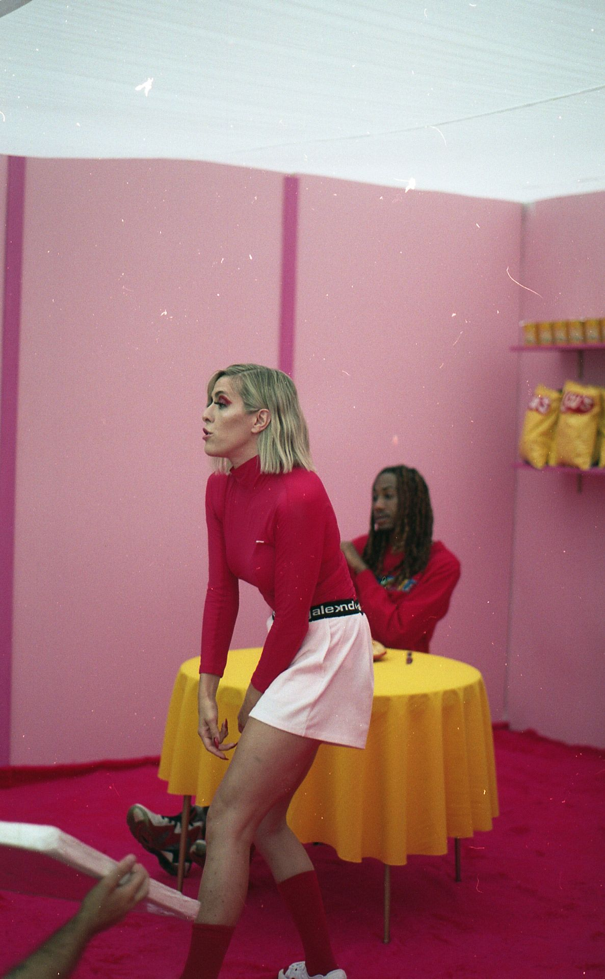 singer Laurence Nerbonne in a pink themed set designed by Studio TB for video clip of her song Uber
