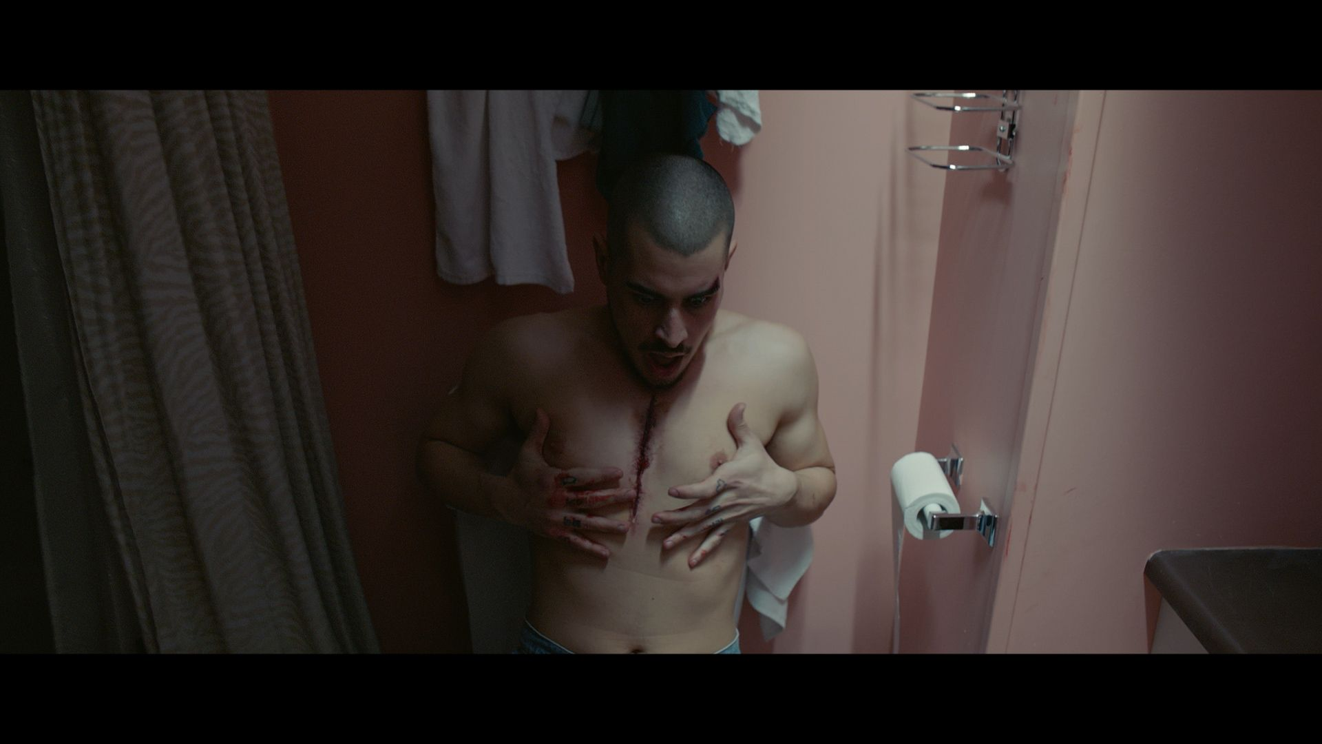 rapper Koriass with wound on his chest for music video of Elephant filmed by Les Gamins