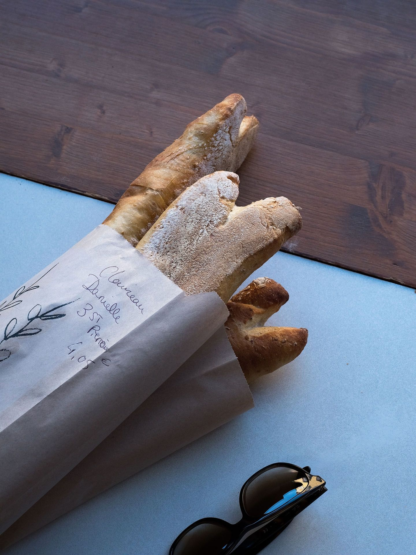 rustique french bread baguettes in brown wrapping paper by Guillaume Simoneau in Saint-Pierre-et-Miquelon for M le mag