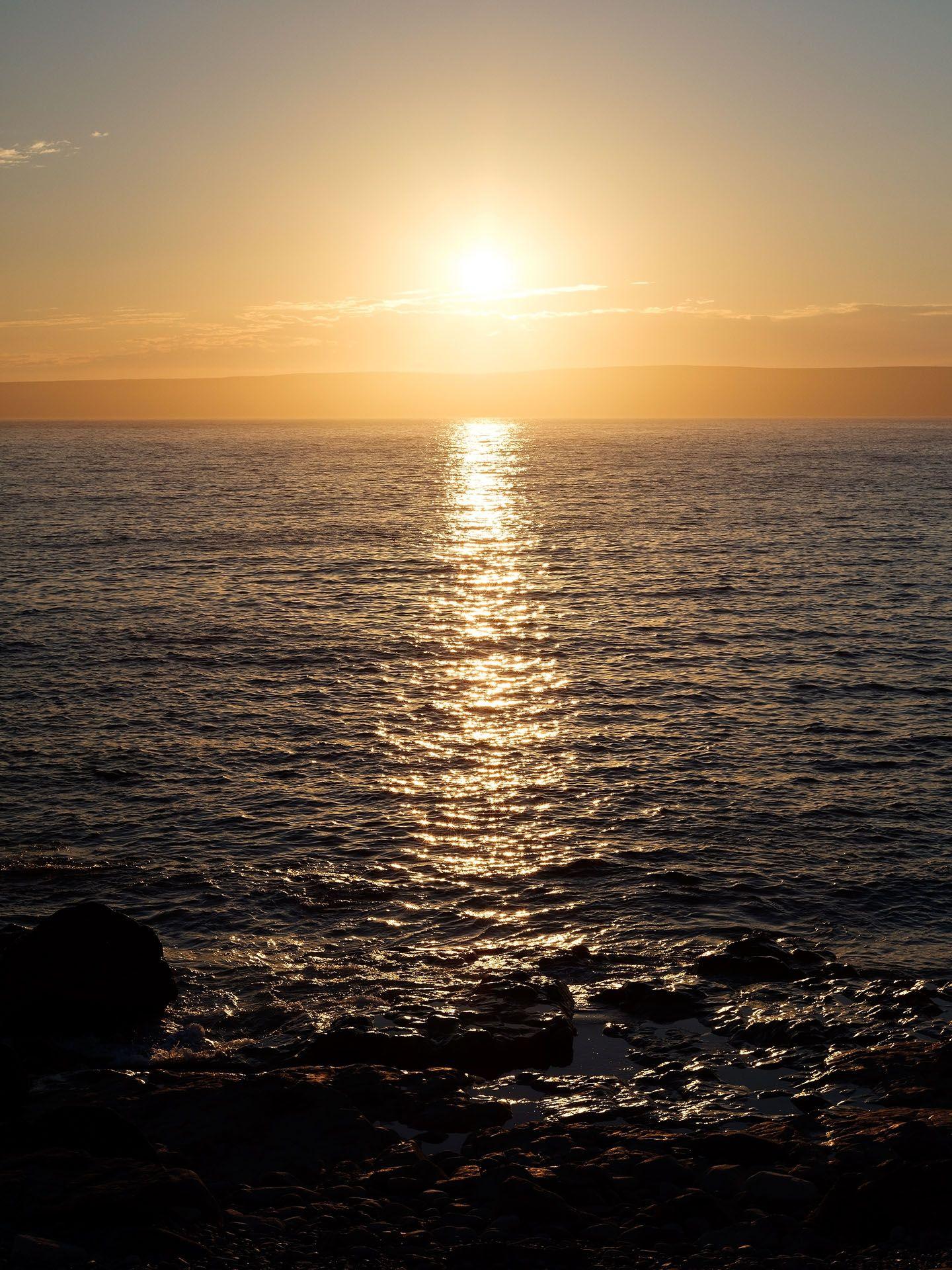 sunrise over the sea by Guillaume Simoneau in Saint-Pierre-et-Miquelon for M le mag Le Monde