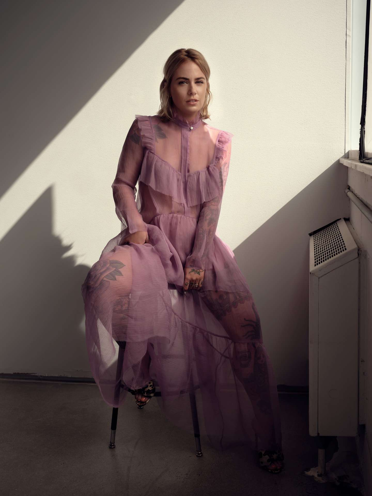 "Valerie Roberts photographed in tulle pink dress sitting on stool by Maxyme G Delisle for Elle Quebec about her book ""La blonde à papa"""