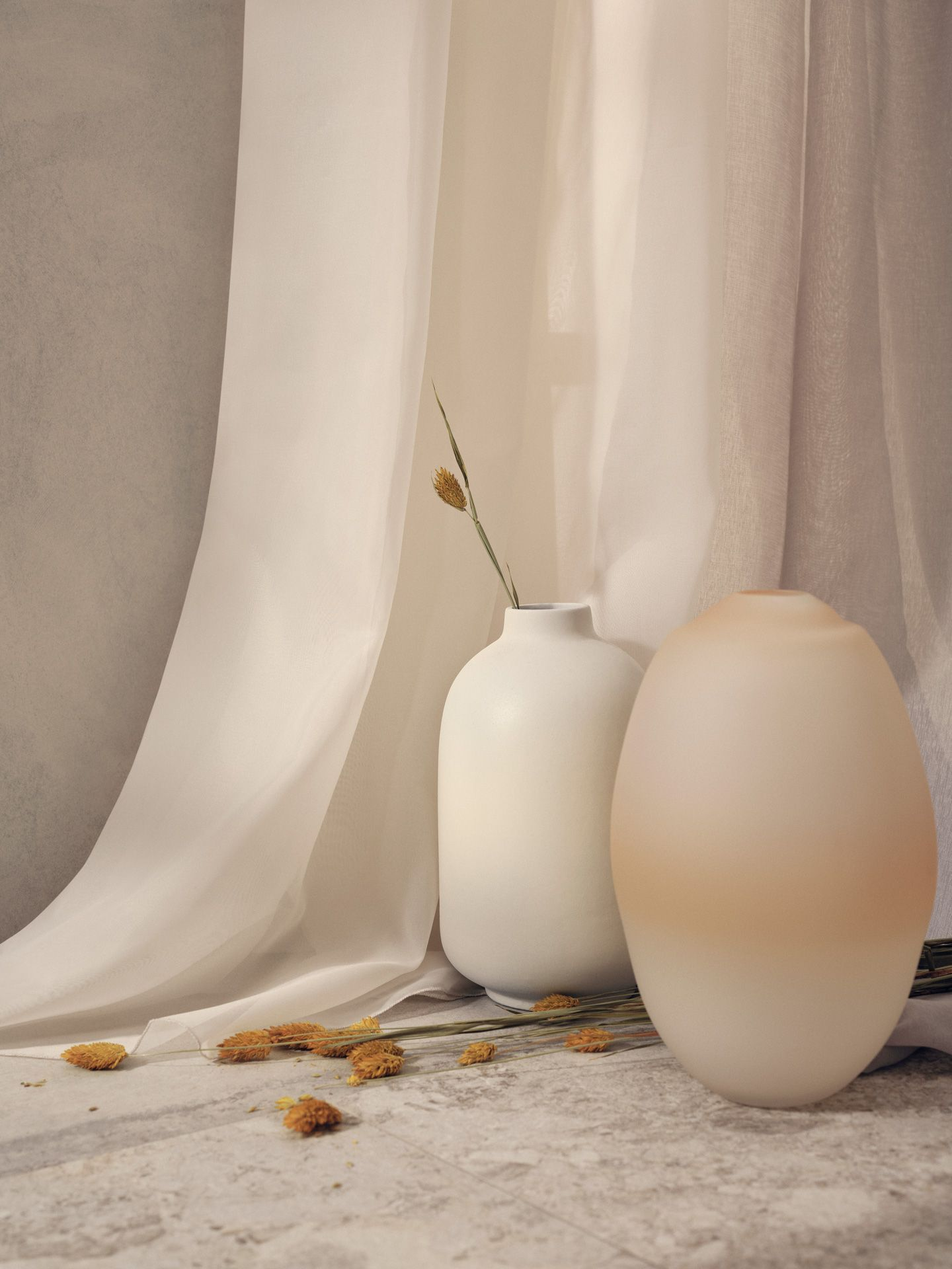 two big vases with single branch of dried plants in them in front of white linen curtains for Jean-Paul Fortin summer-spring collection photographed by Maxyme G Delisle with artistic direction, conception and set design by Studio TB