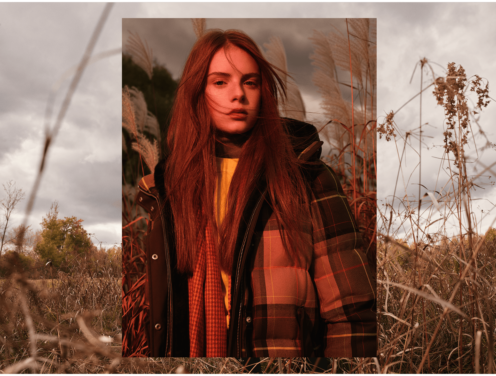 red head model wearing khaki winter coat standing in dry field looking at camera photographed by Maxyme G Delisle for Mackage