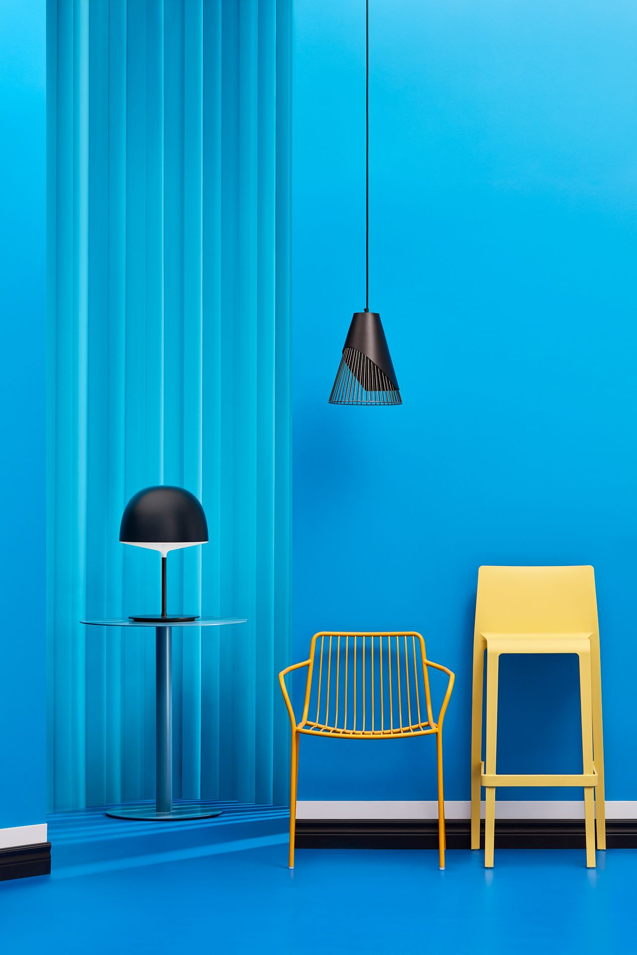 interior design with blue theme with yellow high chair by Mathieu Levesque