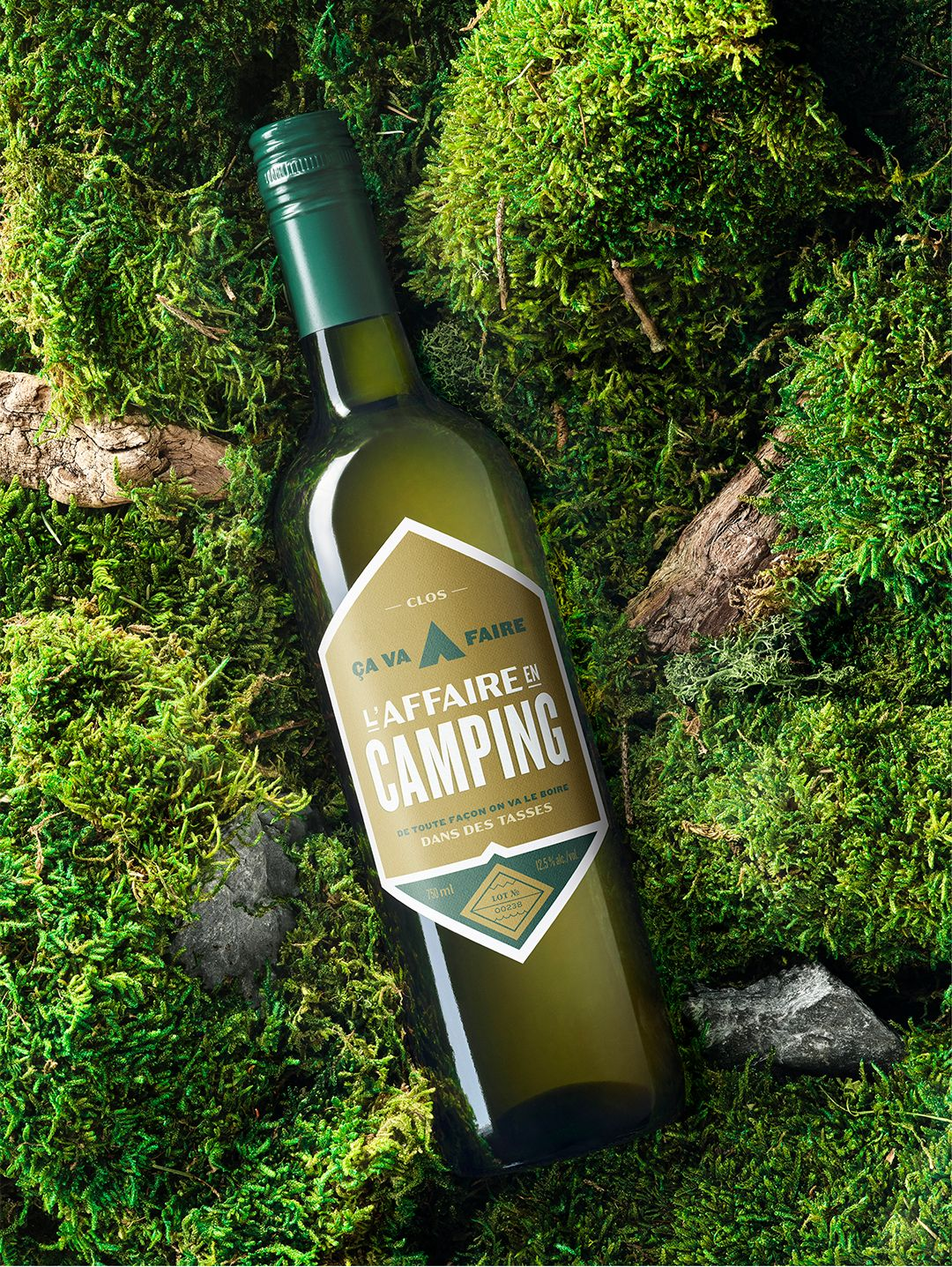 wine bottle on moss and wood photographed by Mathieu Levesque for the SAQ Make Inspired Choices campaign
