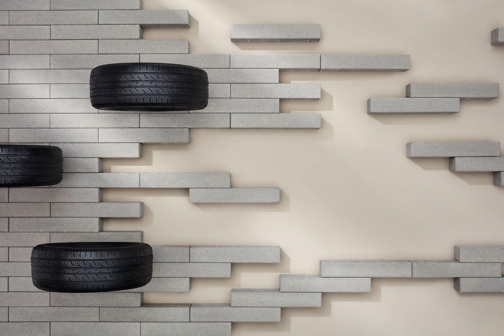 concrete tiles with tires by Mathieu Levesque for Techo Bloc