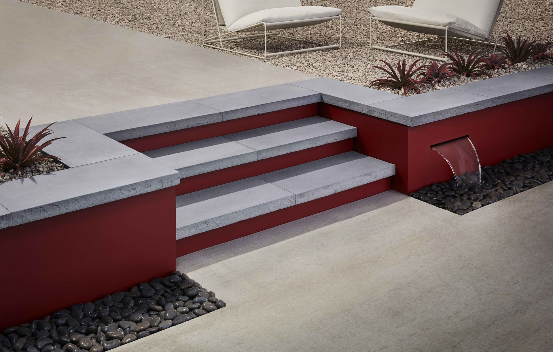 small red stairs with opening of water on stones by Mathieu Levesque for Techo Bloc