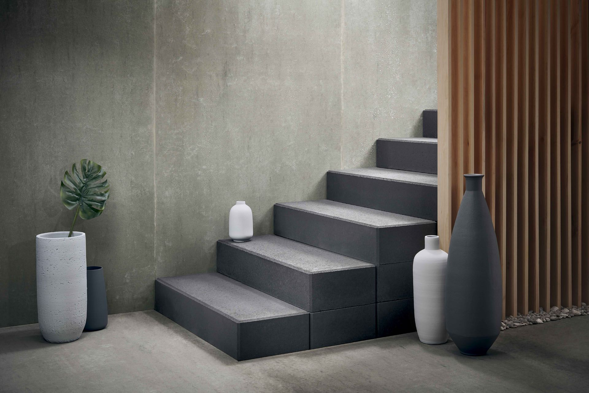 concrete grey stairs with wood slates on side and vases by Mathieu Lévesque for Techo Bloc