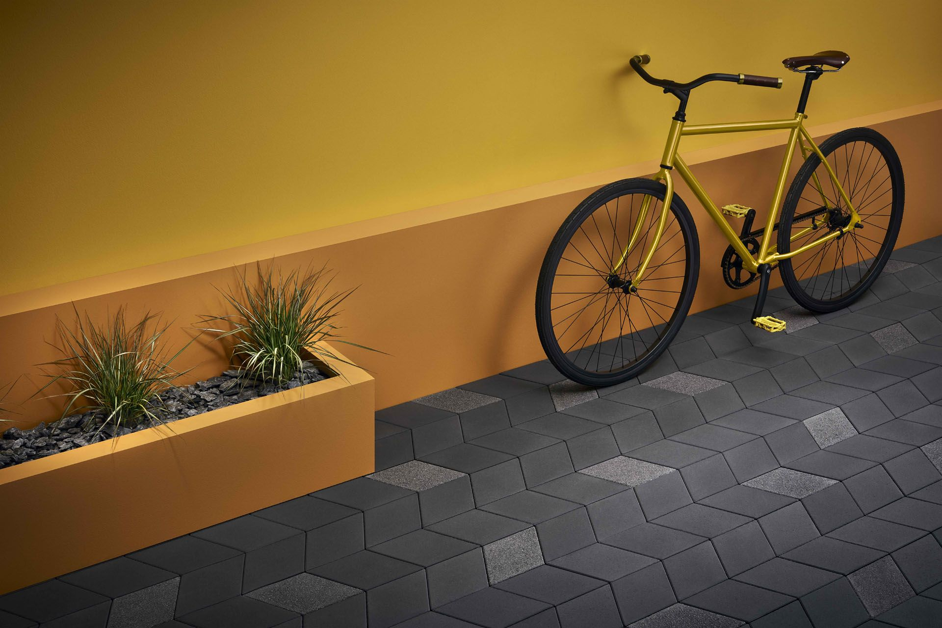 yellow bike on mustard wall by Mathieu Levesque for Techo Bloc
