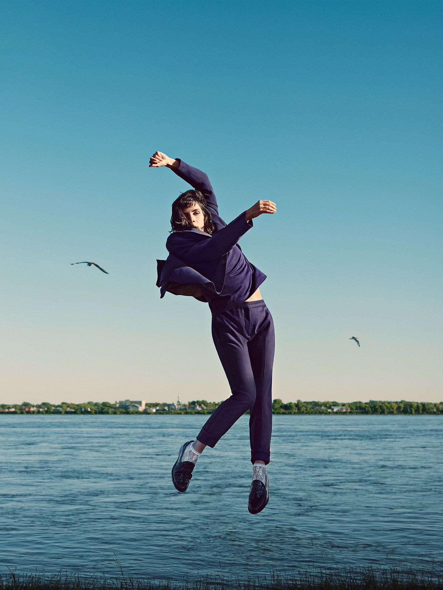 teenage dancer Clara Furey portrait dancing jumping in the air next to a lake by Guillaume Simoneau for Nouveau Projet with Atelier 10