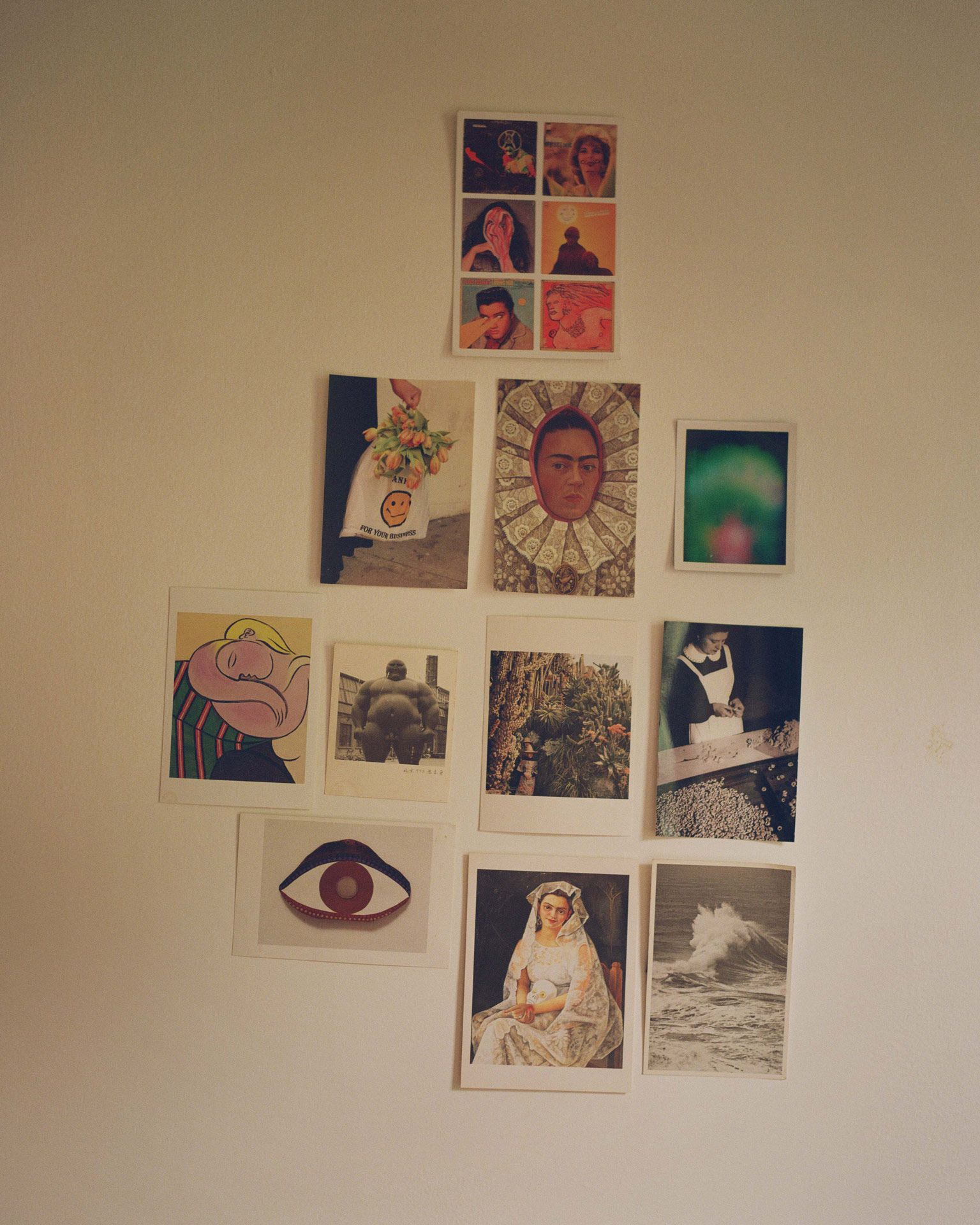 wall of writer Fariha Roisin filled with postcards and pictures photographed by Oumayma B. Tanfous for Levi's