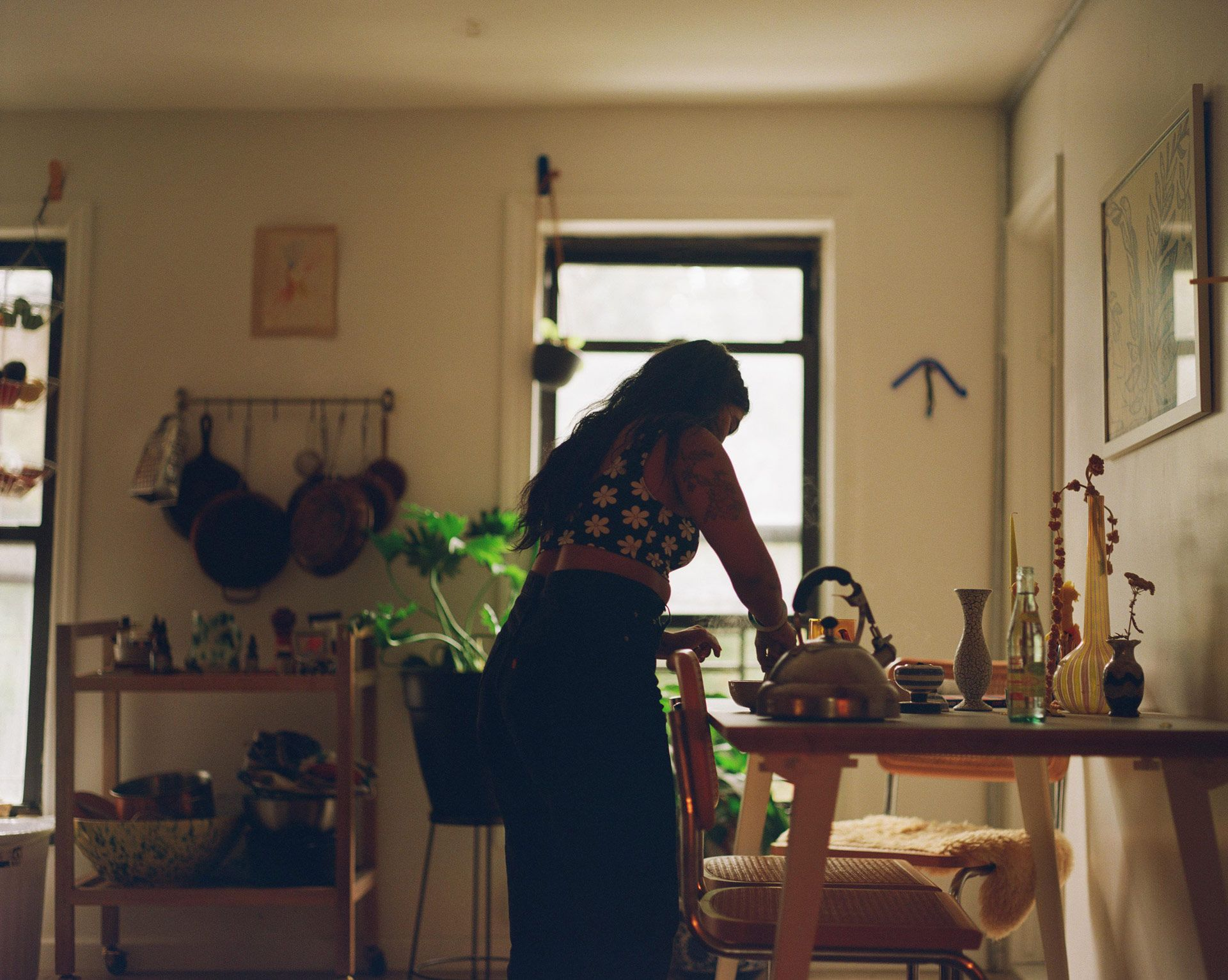 large view of writer Fariha Roisin in her kitchen mixing up matcha powder and hot water in a bowl photographed by Oumayma B. Tanfous for Levi's