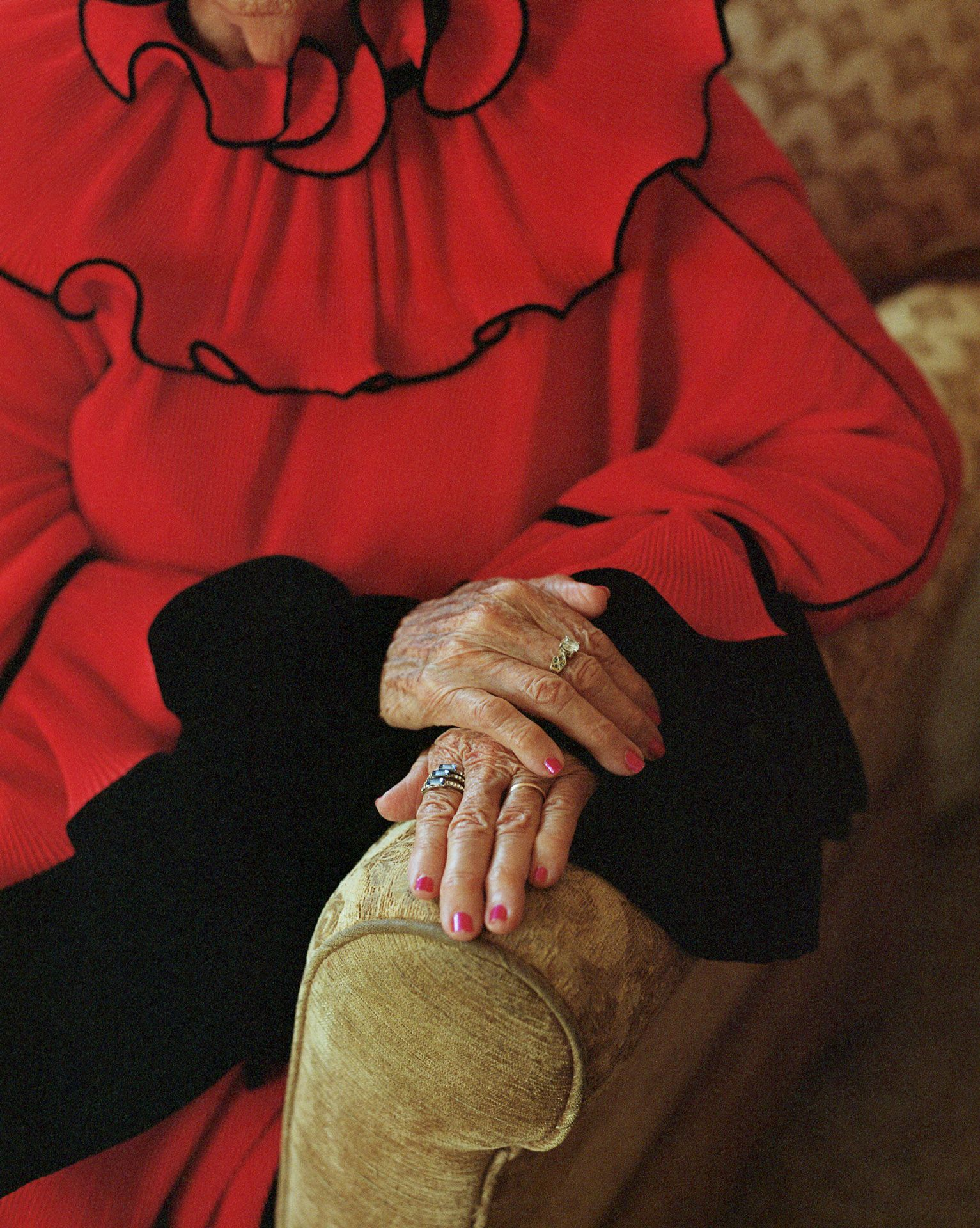 picture of Altagracia de Pena hands with a ring wearing a red dress by Oumayma B. Tanfous for Phosphenes Magazine